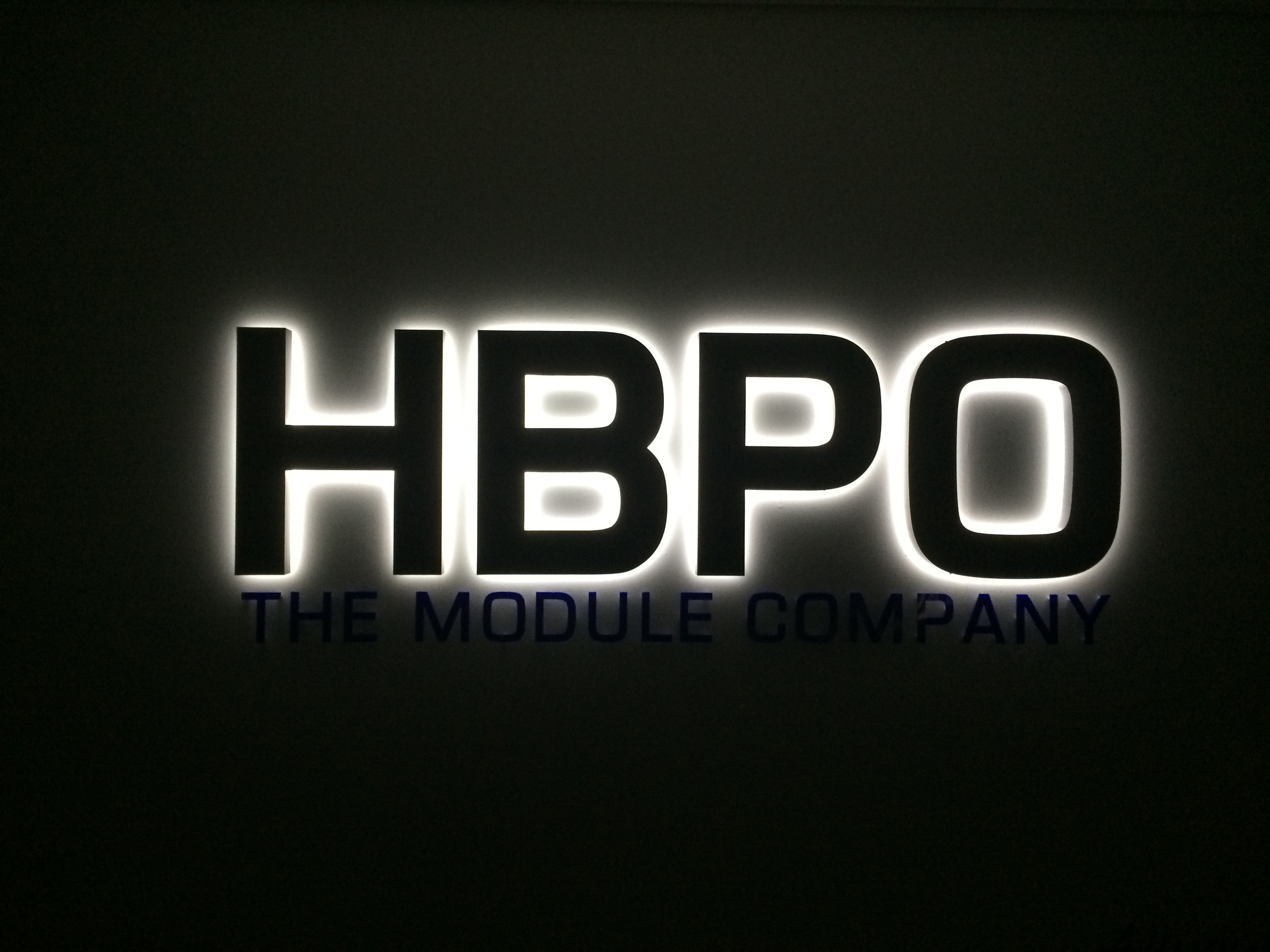 white halo illuminated sign