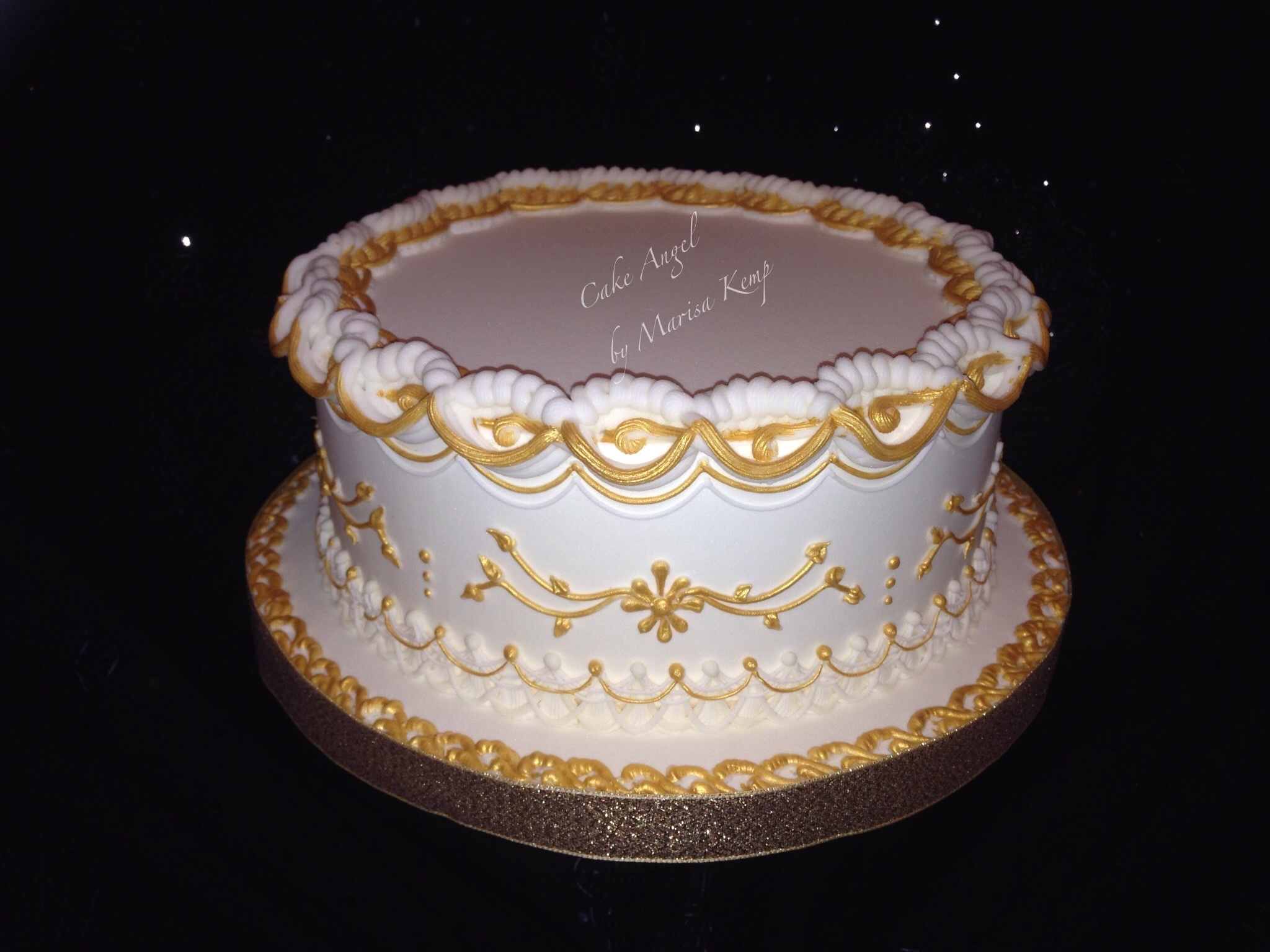 Royal iced white and gold cake