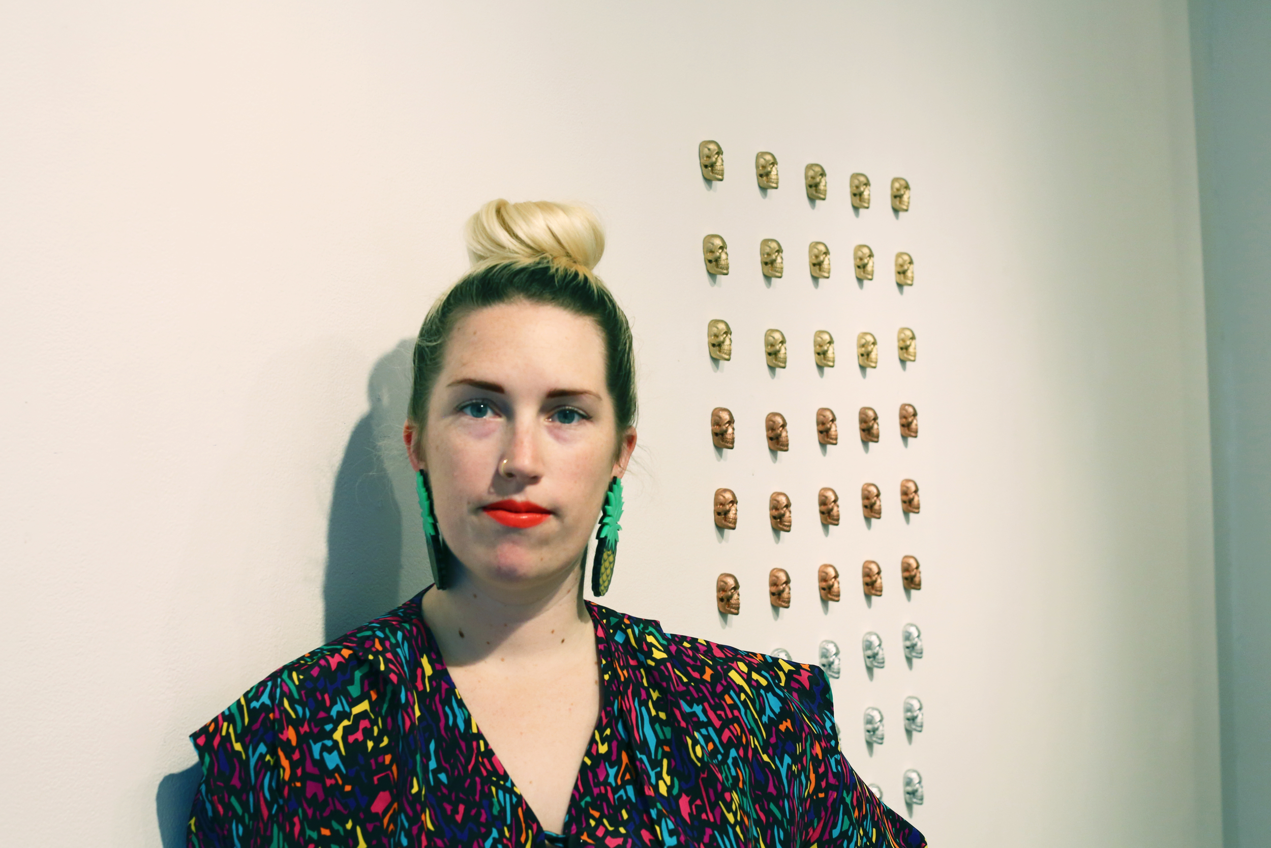 NEW INC Project Manager and curator Alex Darby and her sugar-crafted skulls.