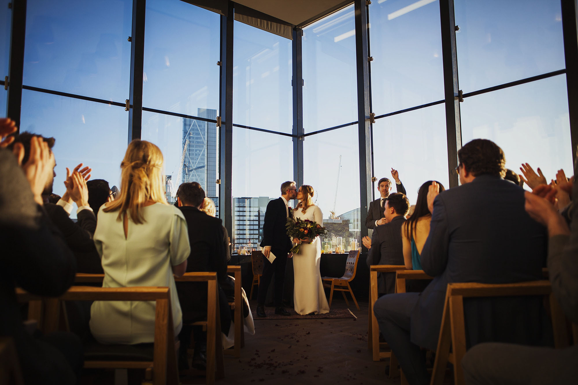 bride and groom first kiss at the ace hotel london