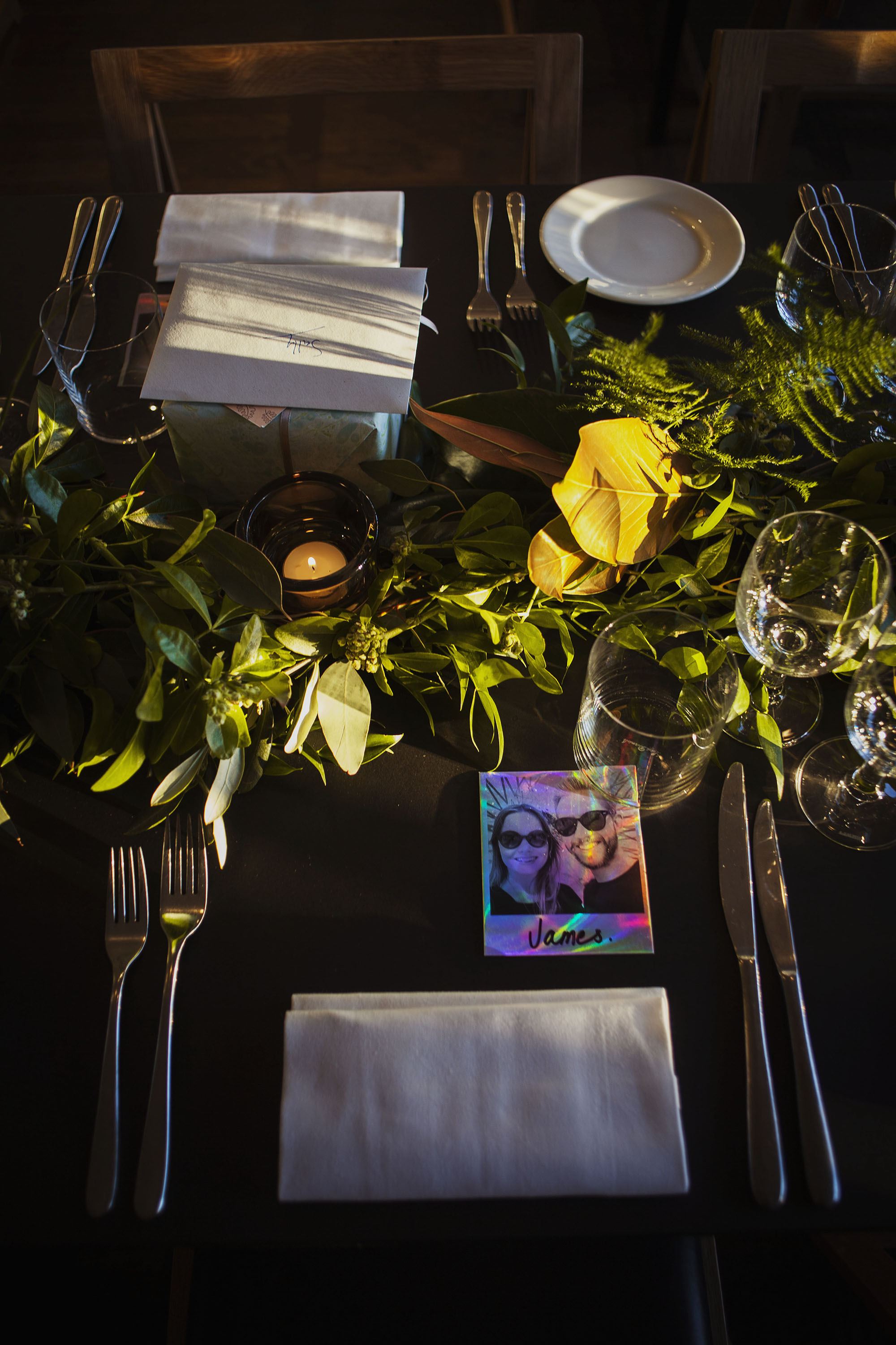 wedding breakfast table with candle polaroid photo and wedding flowers at the ace hotel london