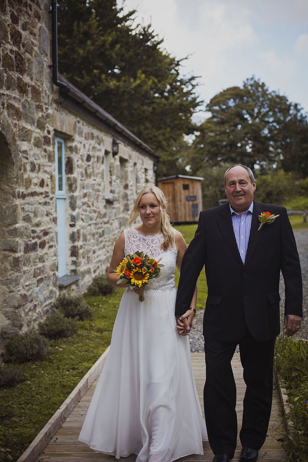 bride and father of the bride walking to ceremony at nantwen