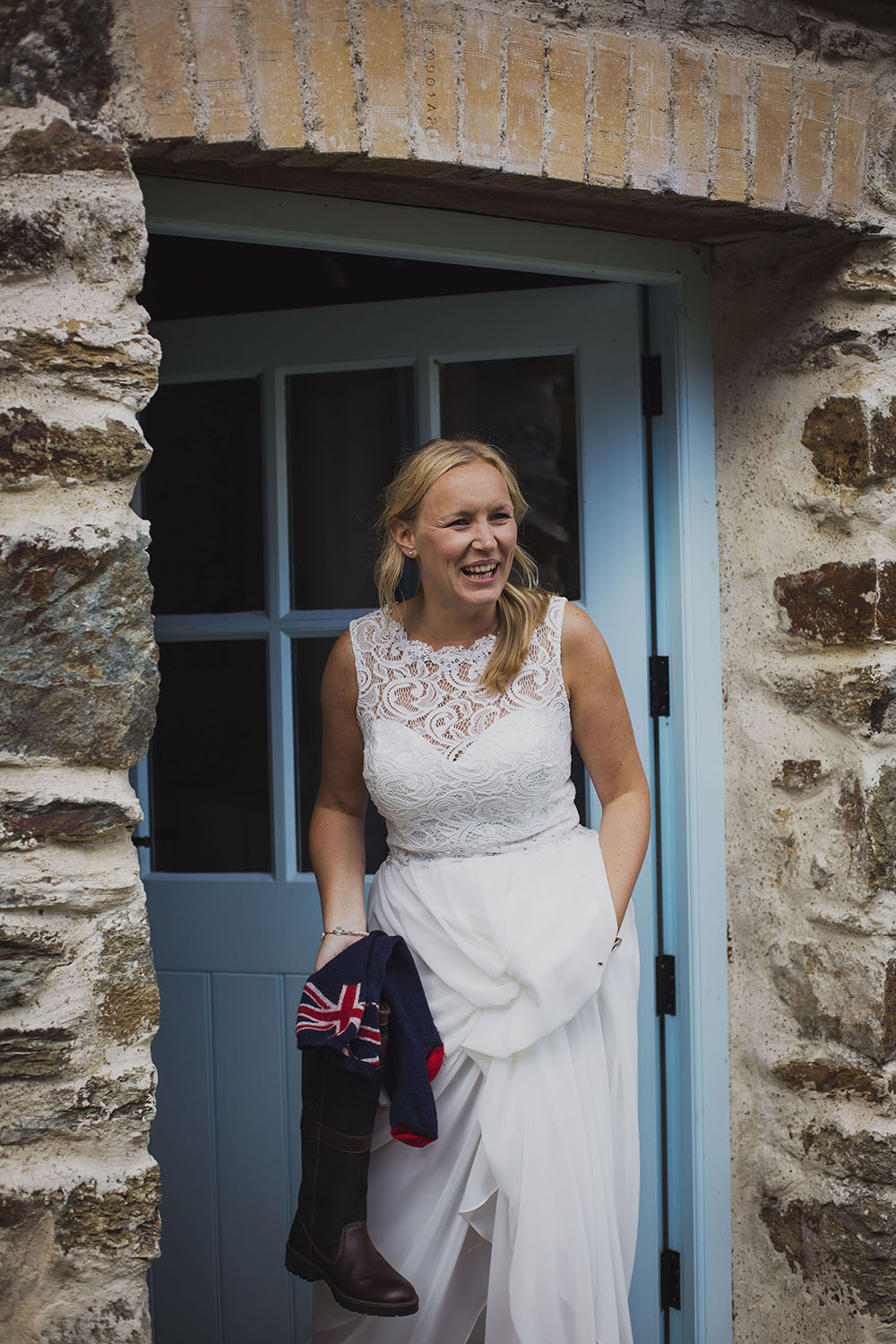 bride in doorway with wellies at nantwen