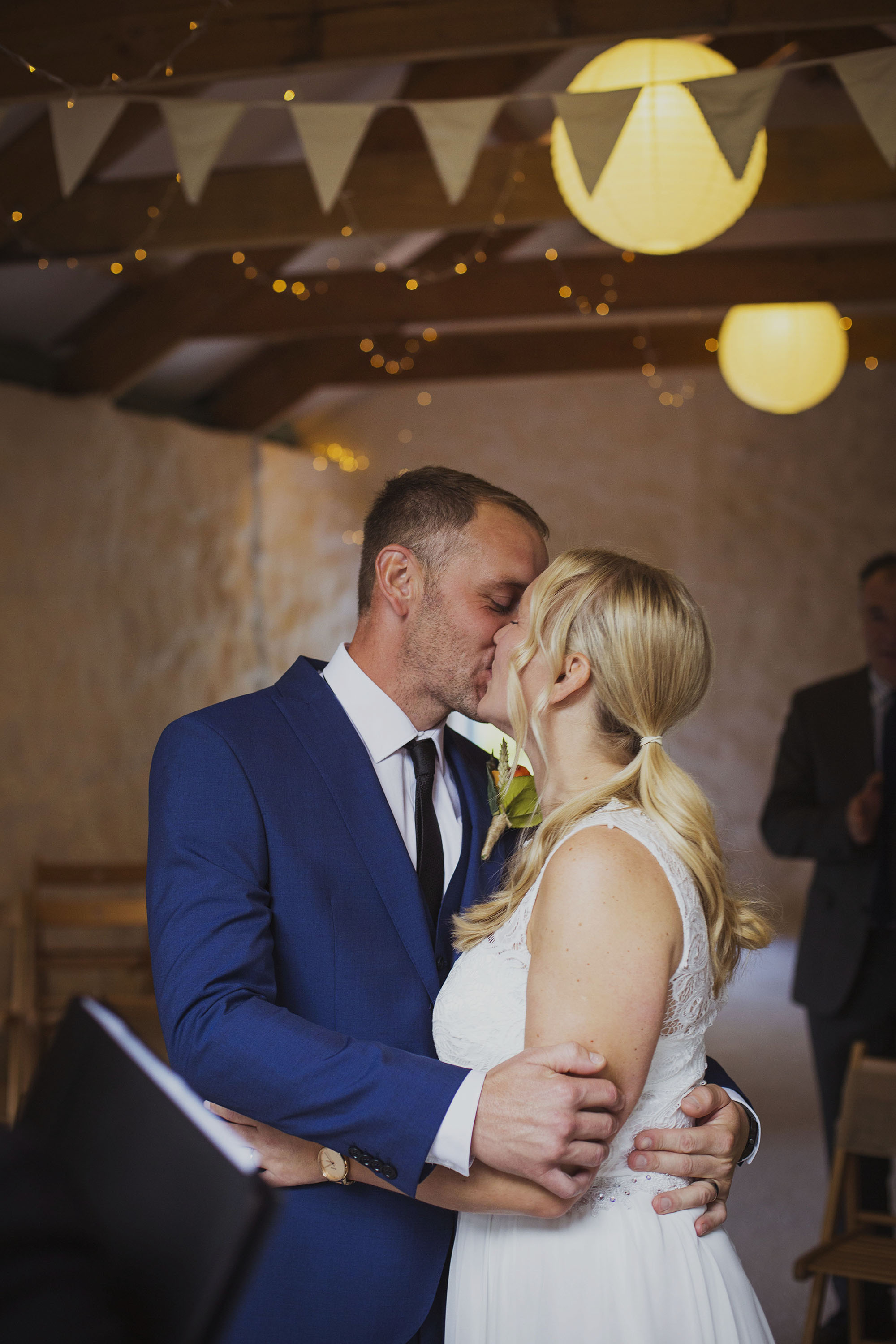bride and groom first kiss at nantwen wedding venue