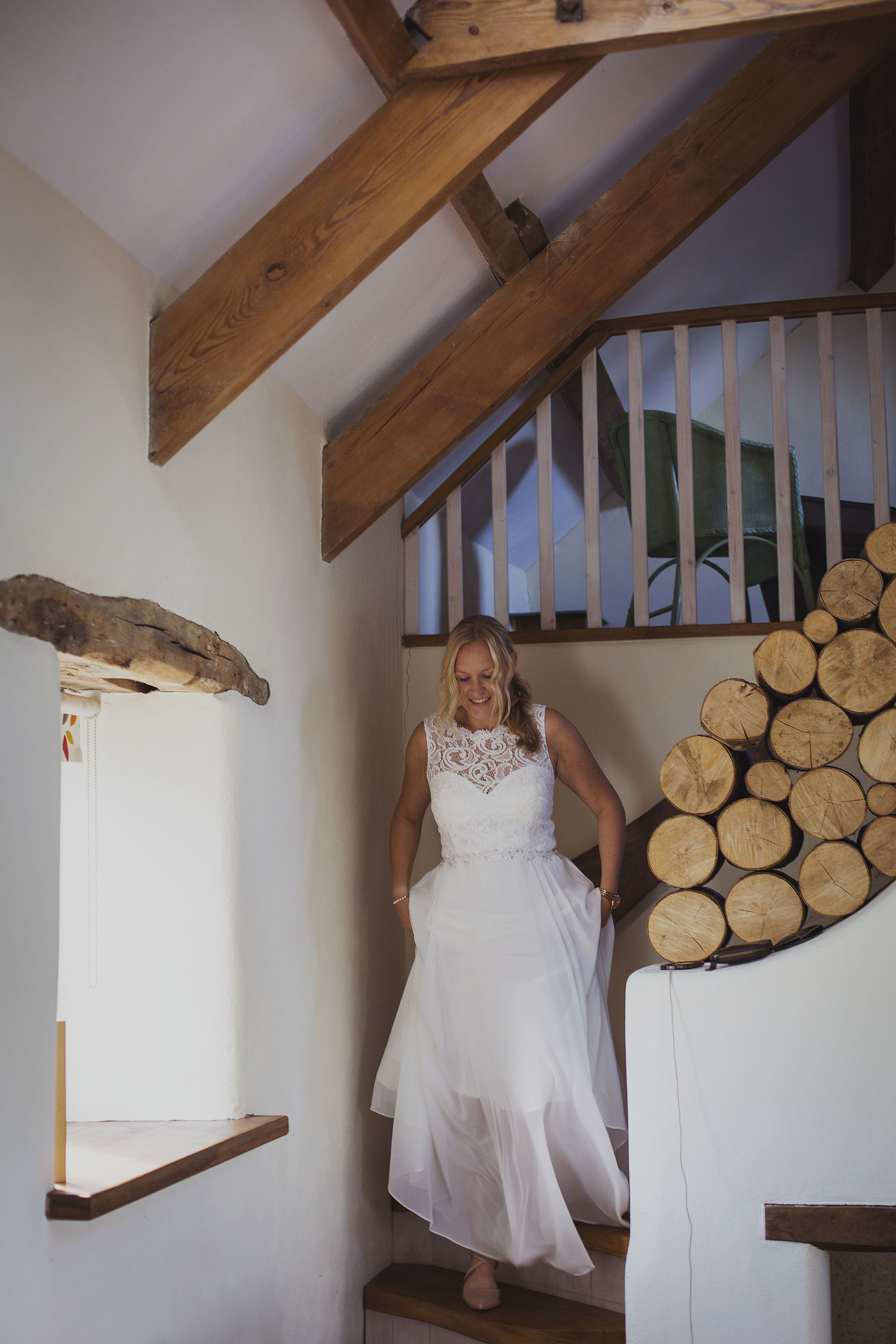 bride walking down stairs at nantwen wedding venue