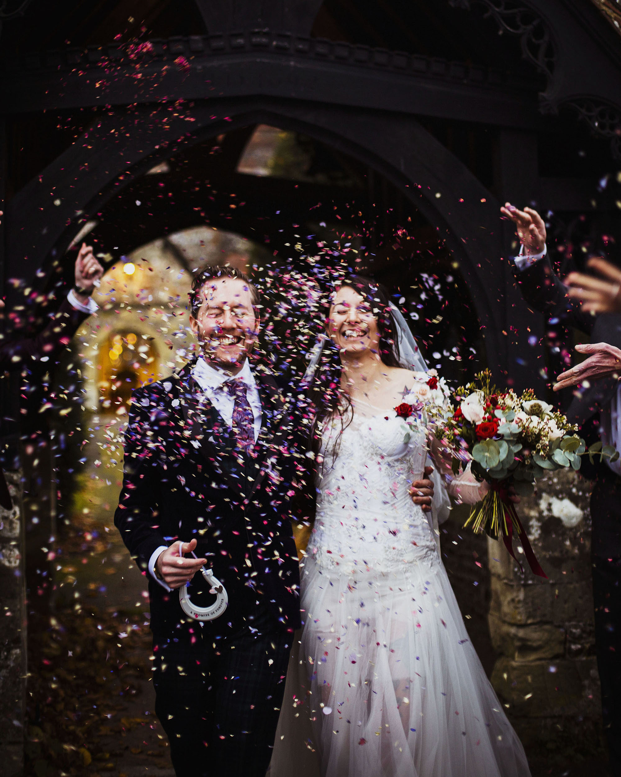 bride and groom confetti photo at barford park in wiltshire