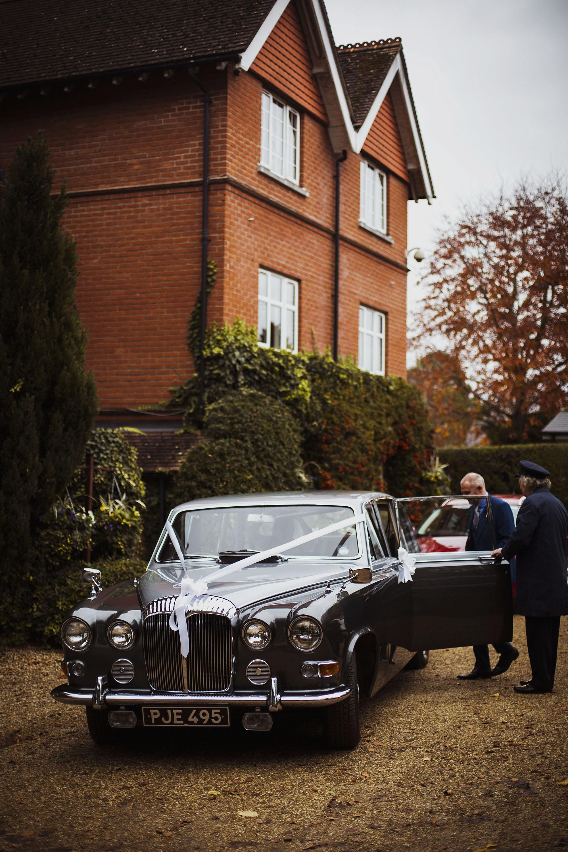 bride getting into vintage car at grasmere house hotel