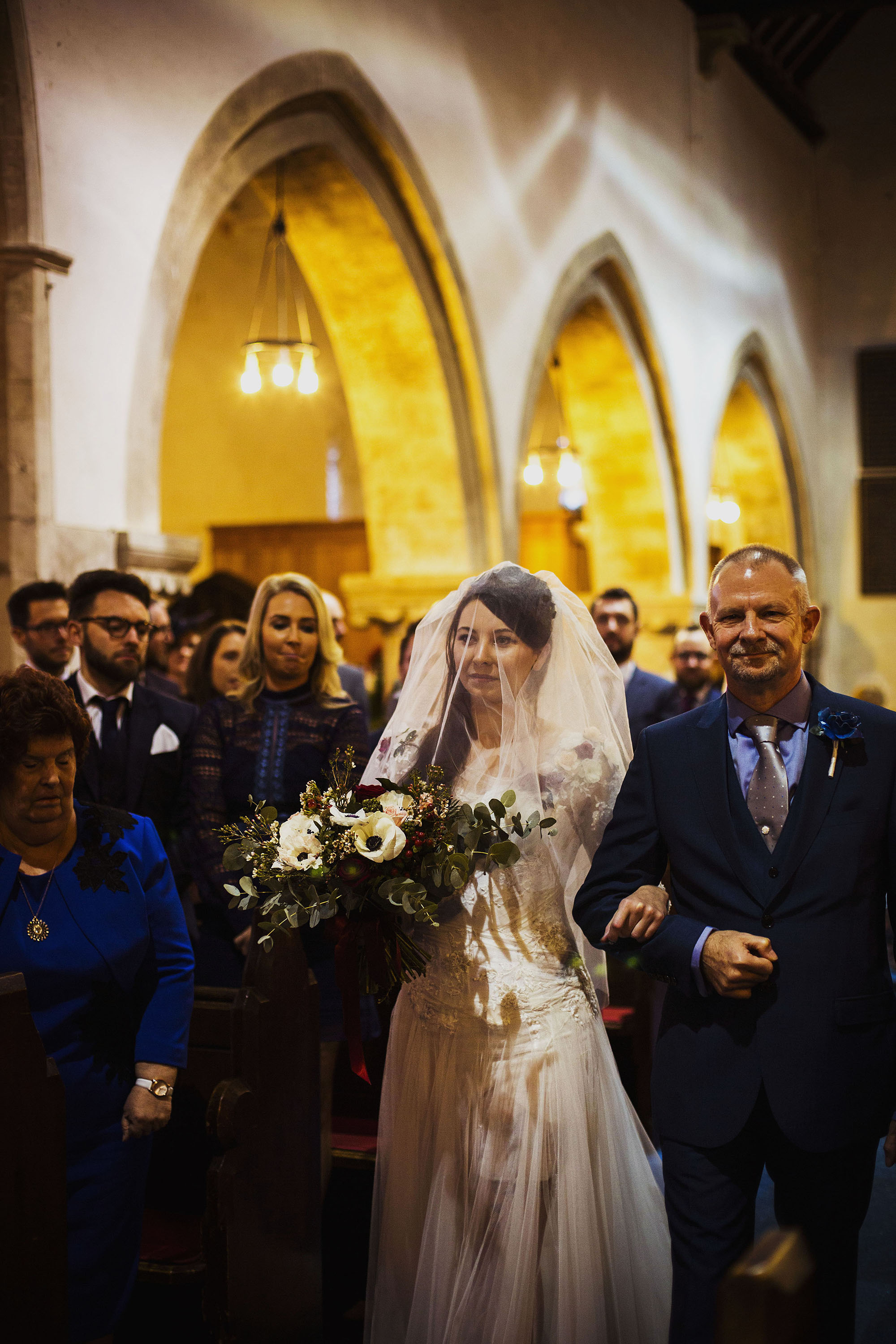 bride and father walking down the isle at st laurence church