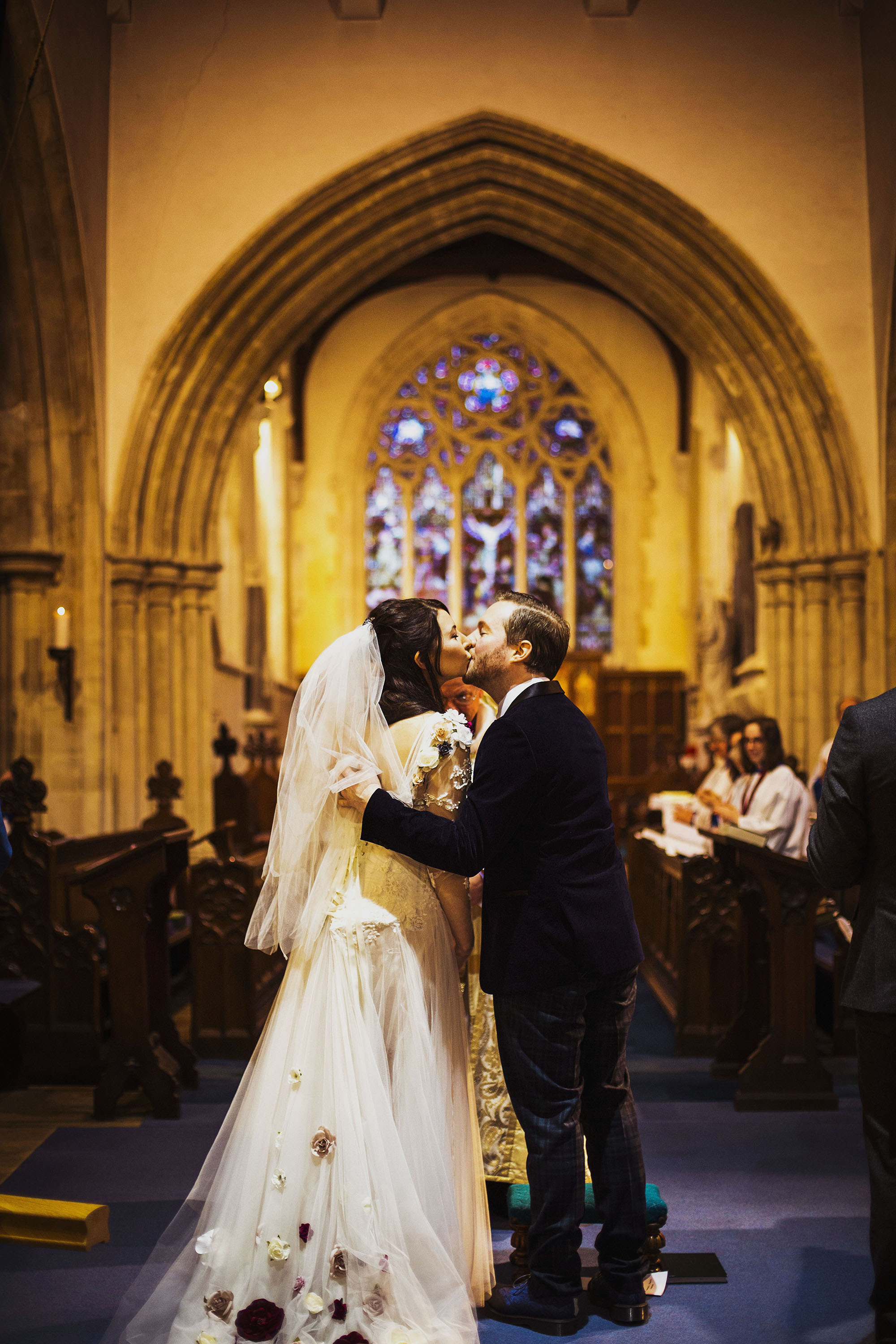 bride and groom first kiss at st laurence church
