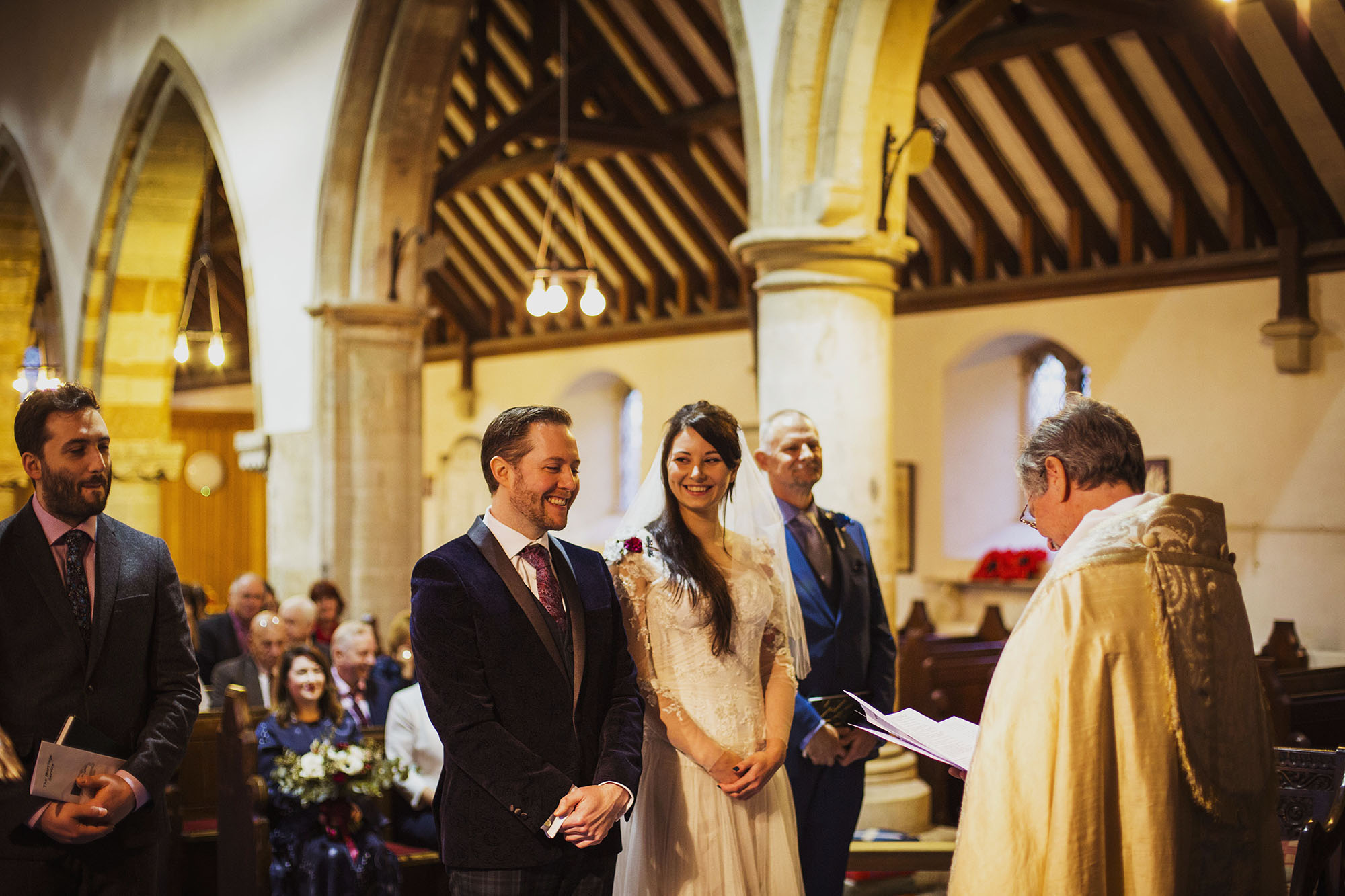 bride and groom smiling at st laurence church