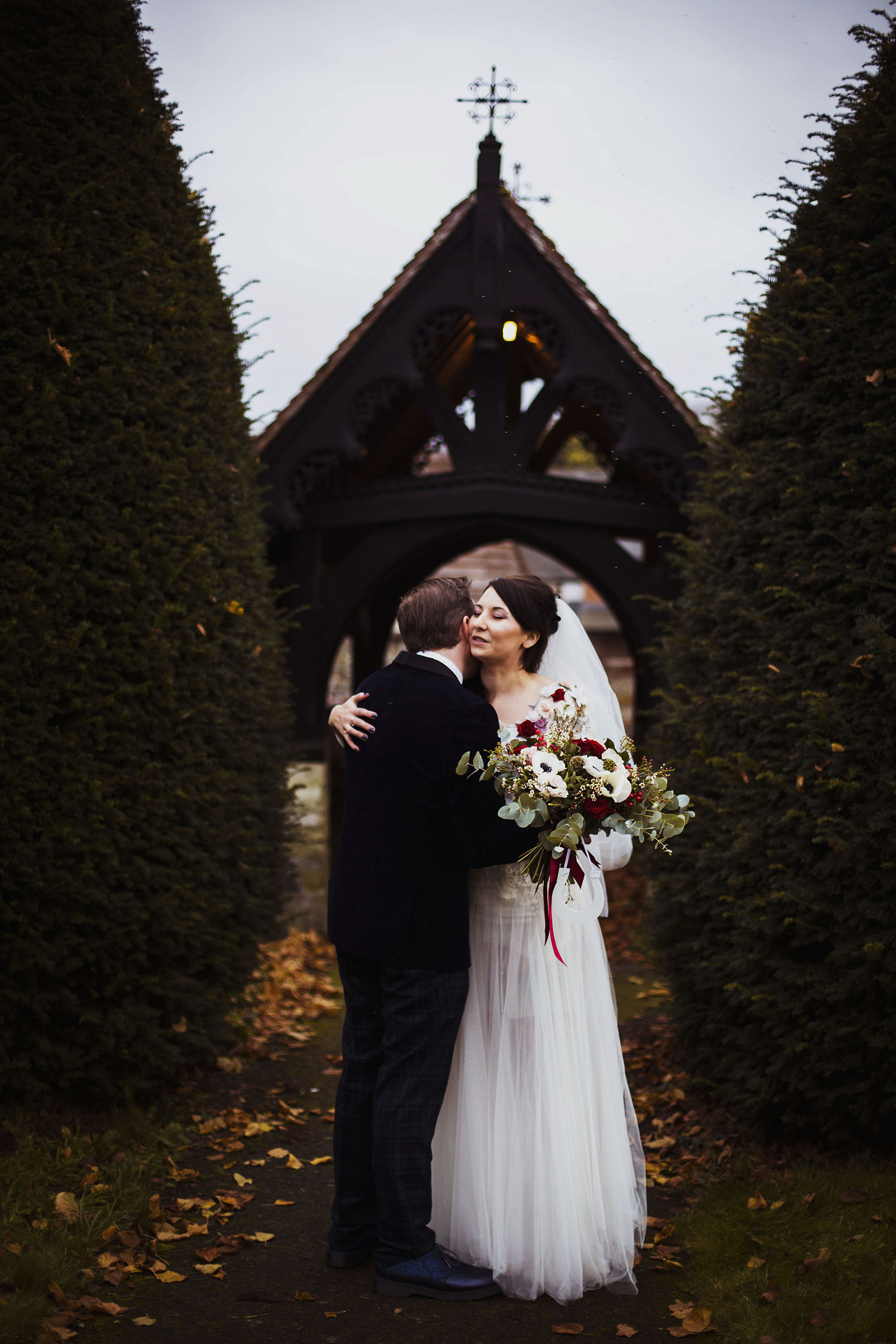 bride and groom having a cuddle just married at st laurence church