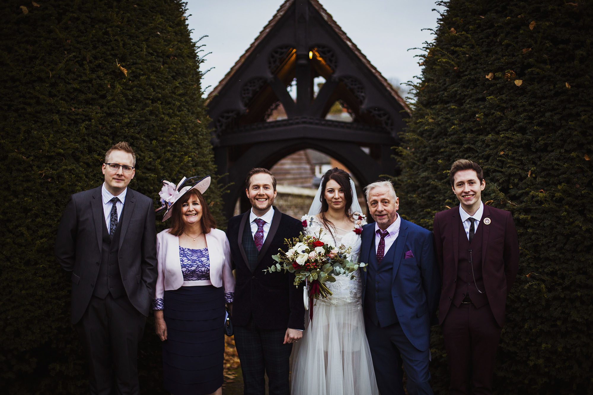 bride and groom with groom's family at st laurence church