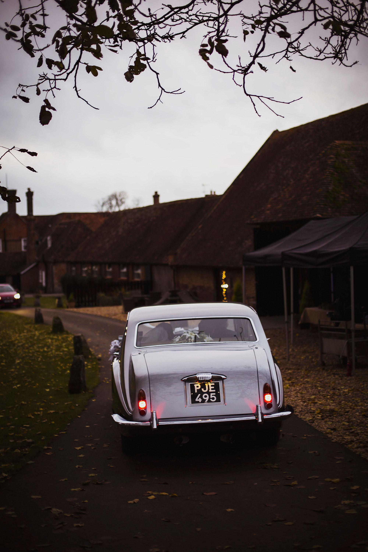 vintage car arriving at barford park wedding venue in wiltshire