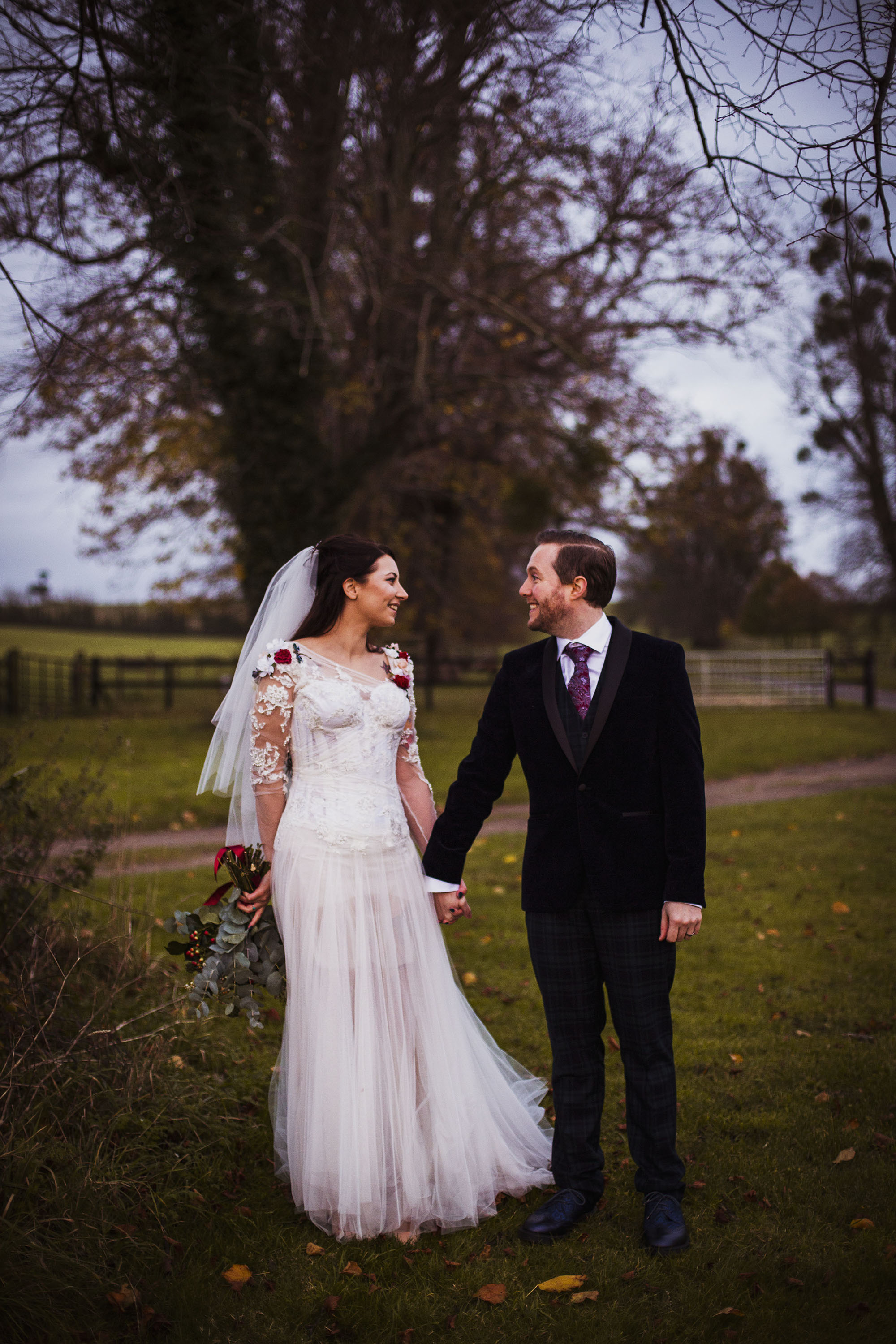 bride and groom smiling at each other at barford park wedding venue in wiltshire