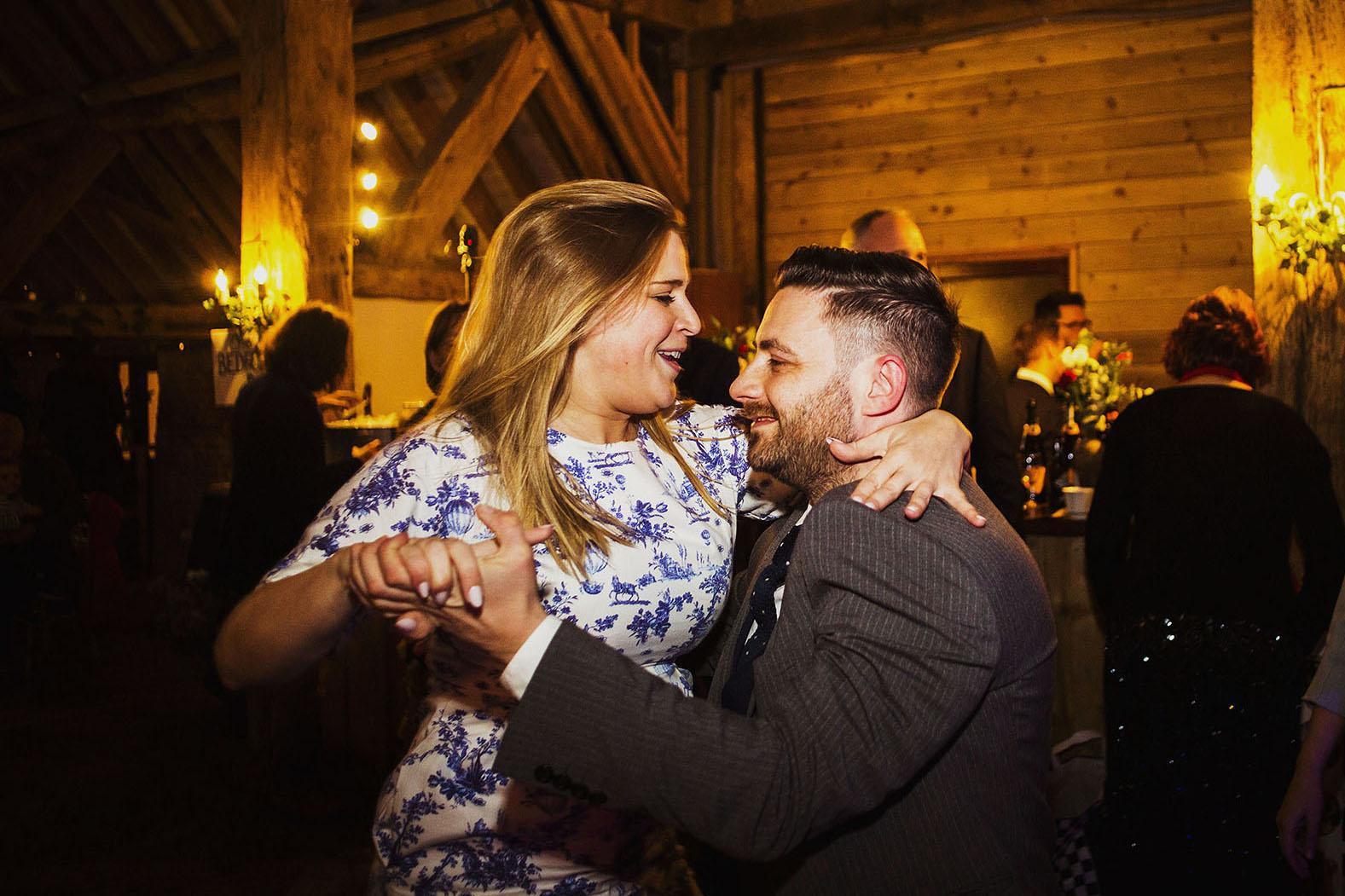 wedding guests dancing at wedding reception at barford park wedding venue in wiltshire