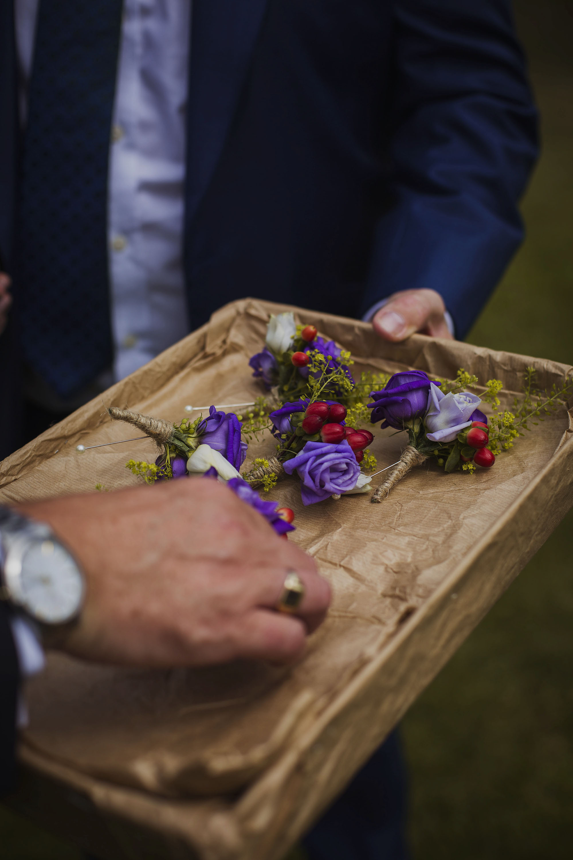 button holes flowers at wedding at usk castle