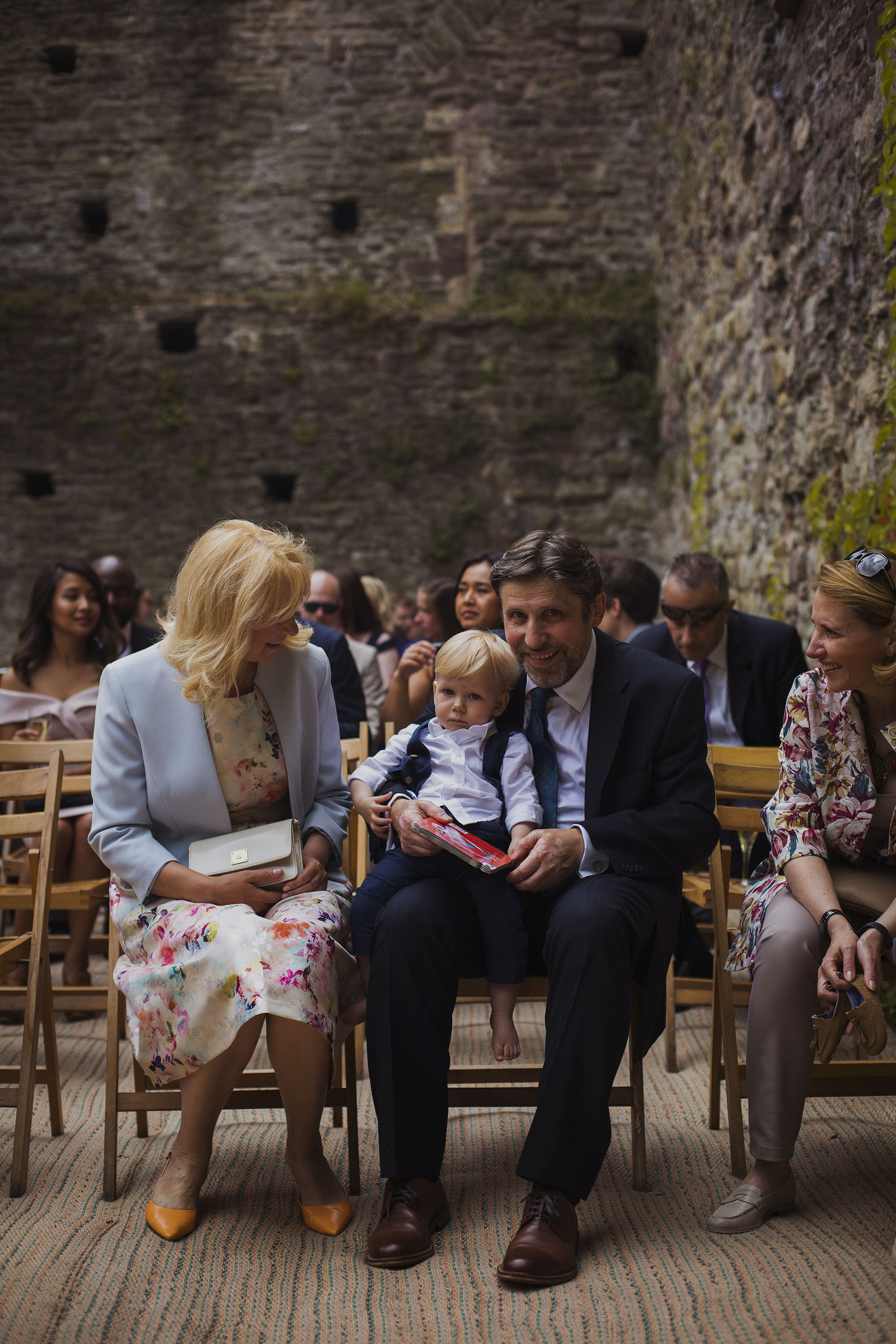 father of the groom with bride and groom's son at usk castle