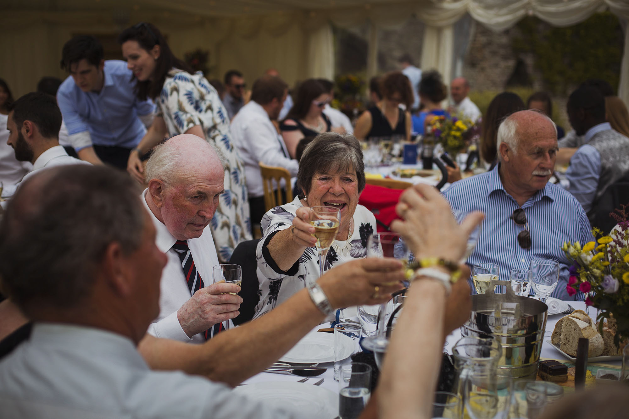 wedding guests cheers at usk castle