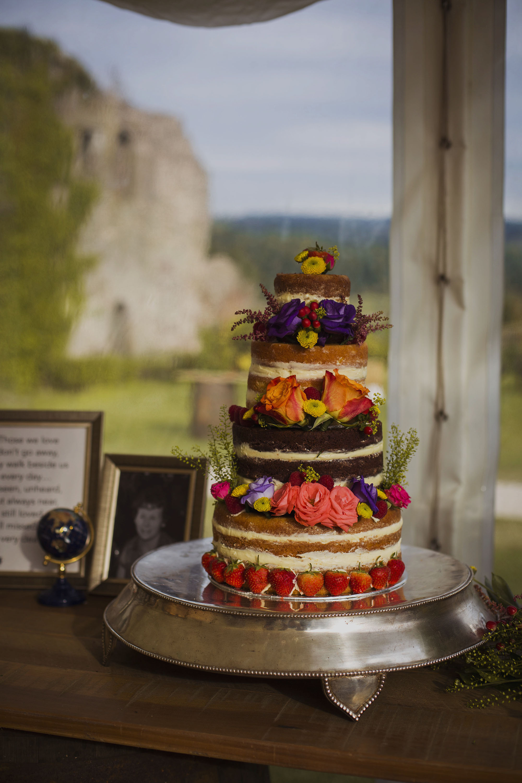 naked floral wedding cake at usk castle