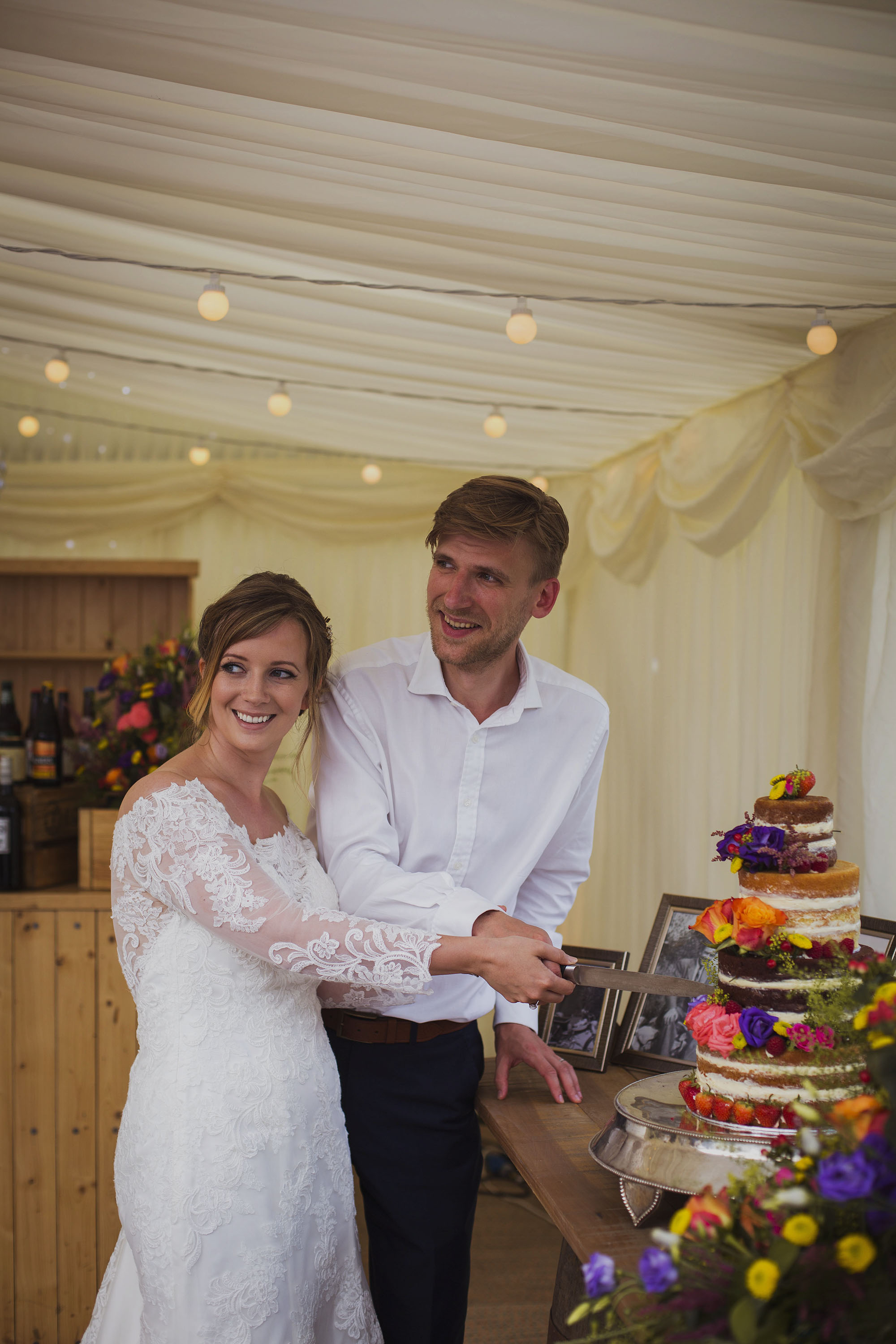 bride and groom cutting their wedding cake at usk castle