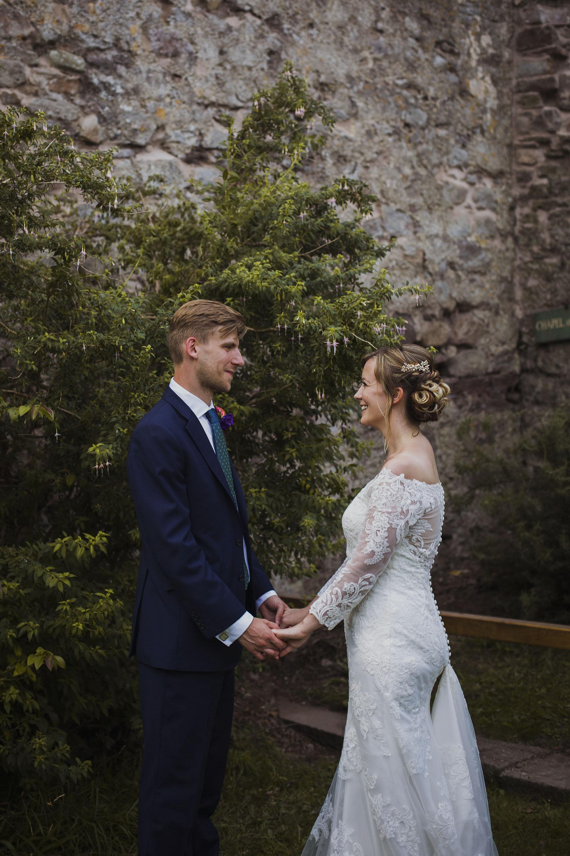 bride and groom at usk castle wedding venue