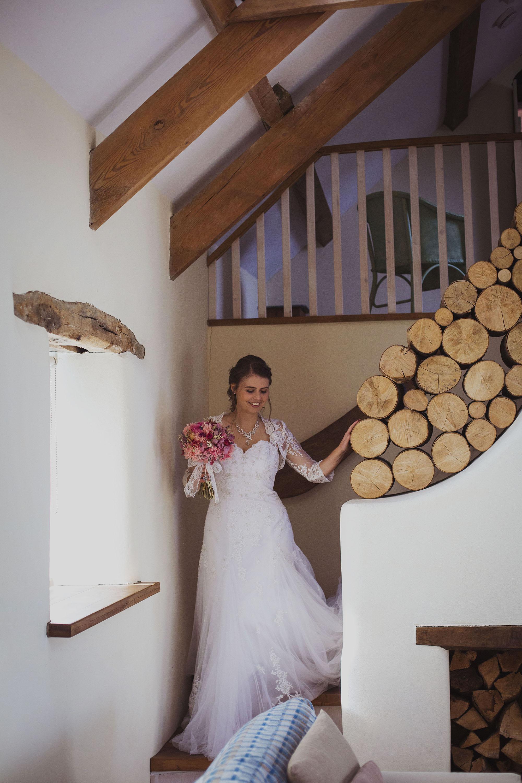 bride walking down stairs at nantwen wedding venue