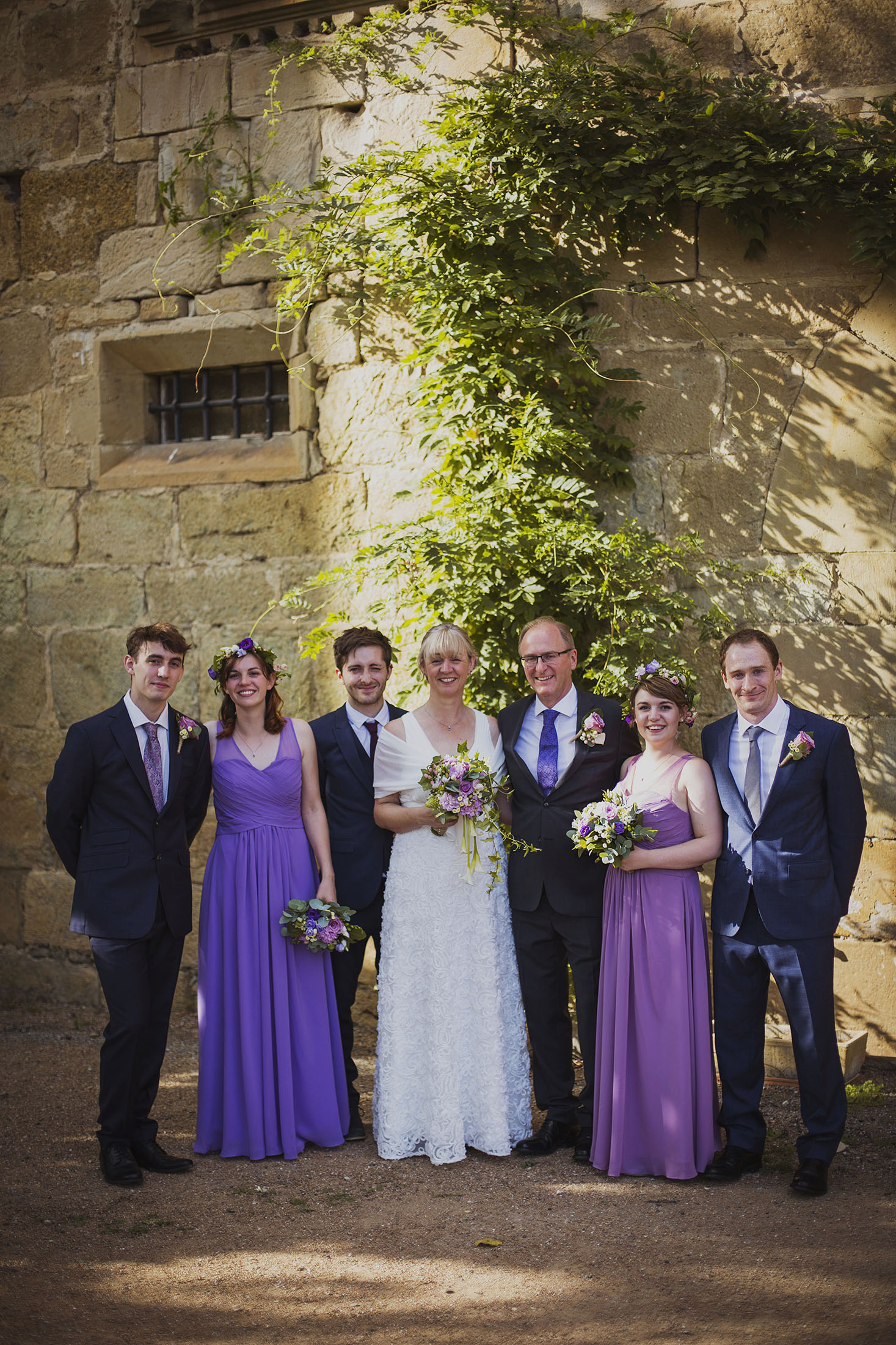 bride and groom with children at chateaux des ducs de joyeuses france destination wedding photography