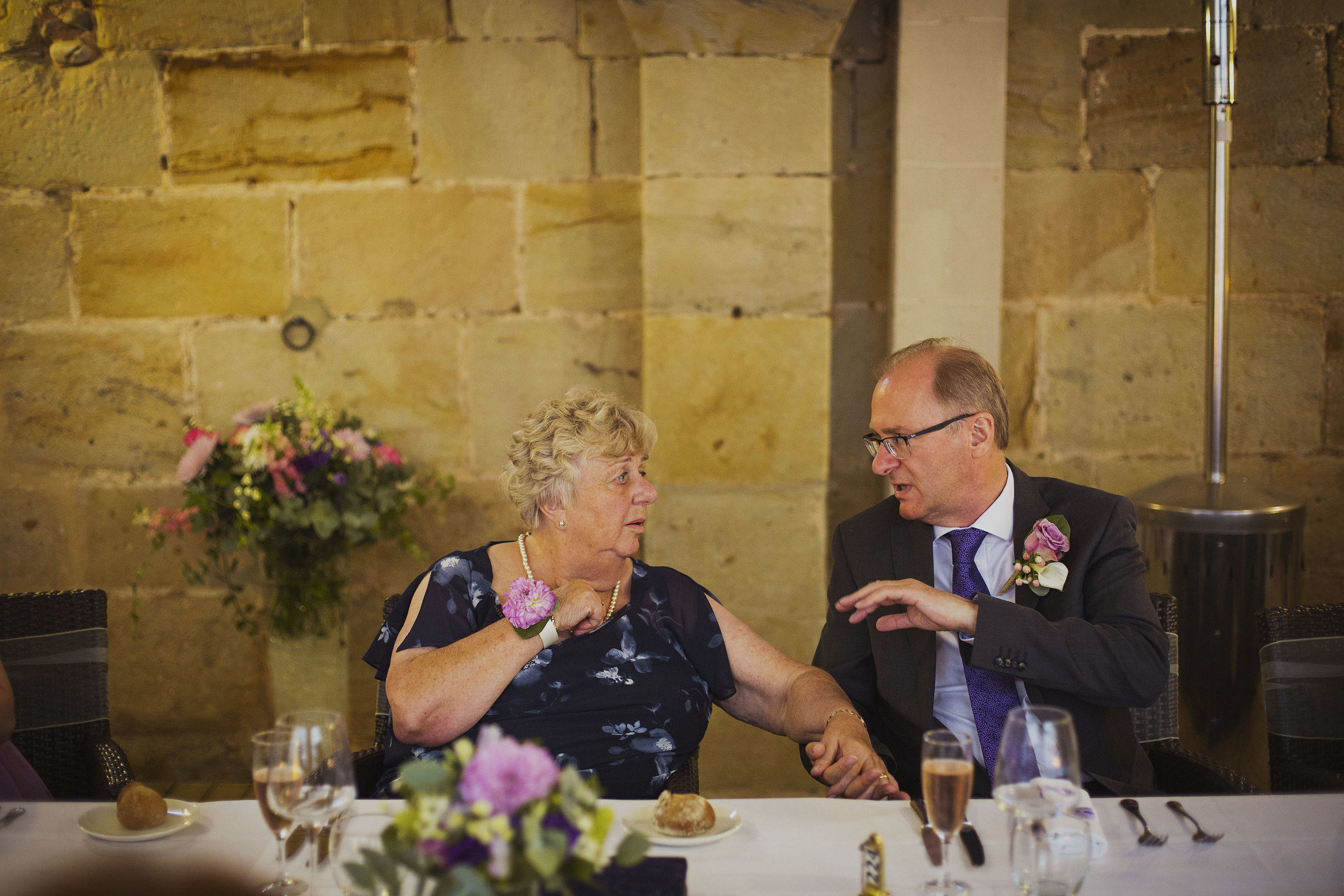 groom with mother at wedding breakfast at chateaux des ducs de joyeuses france destination wedding photography