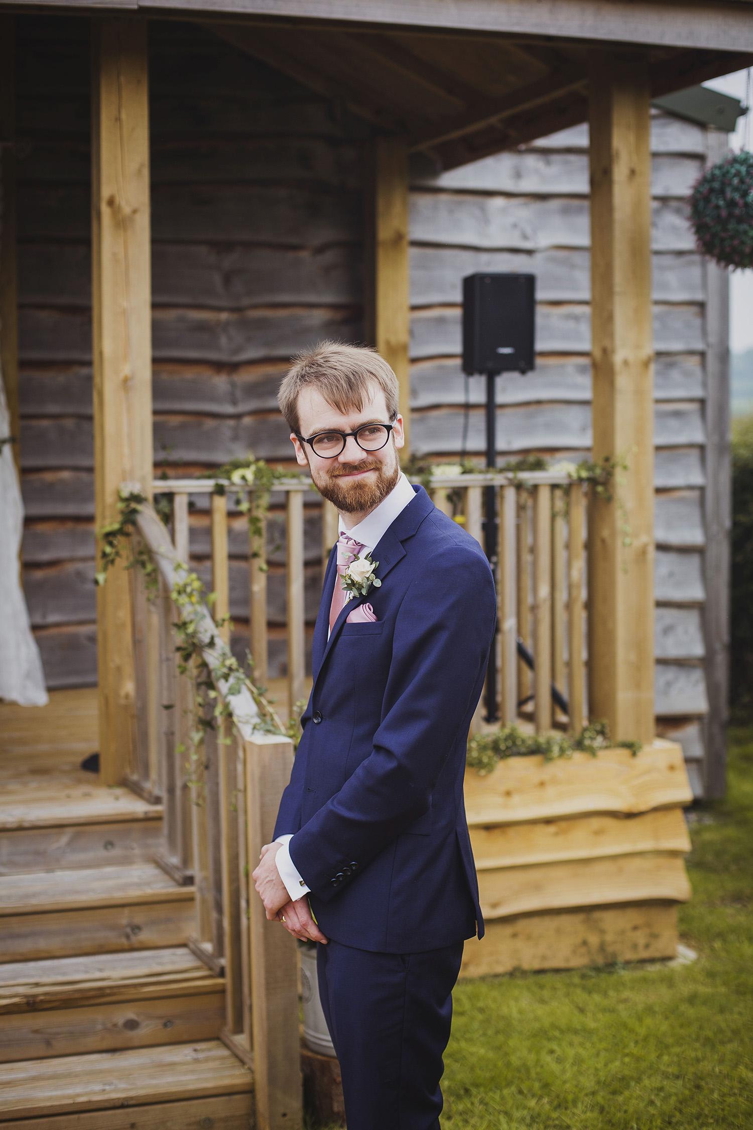 groom's reaction to bride at cott farm barn somerset wedding venue