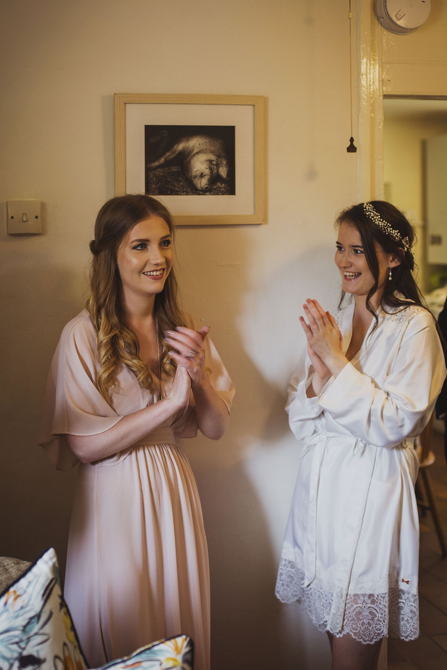 bride and bridesmaid getting ready for cott farm barn somerset wedding