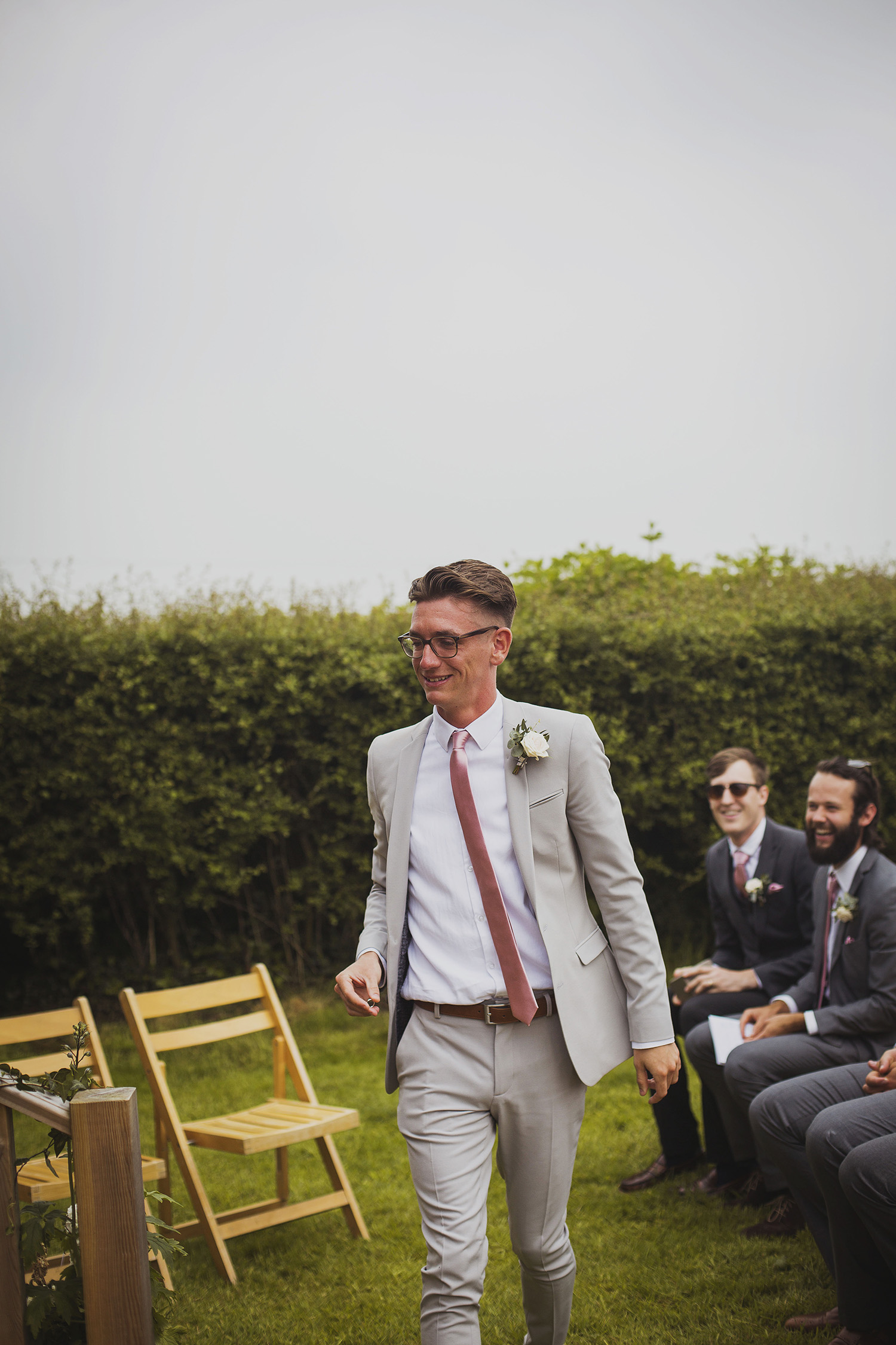 best man bringing rings at wedding ceremony at cott farm barn wedding venue somerset