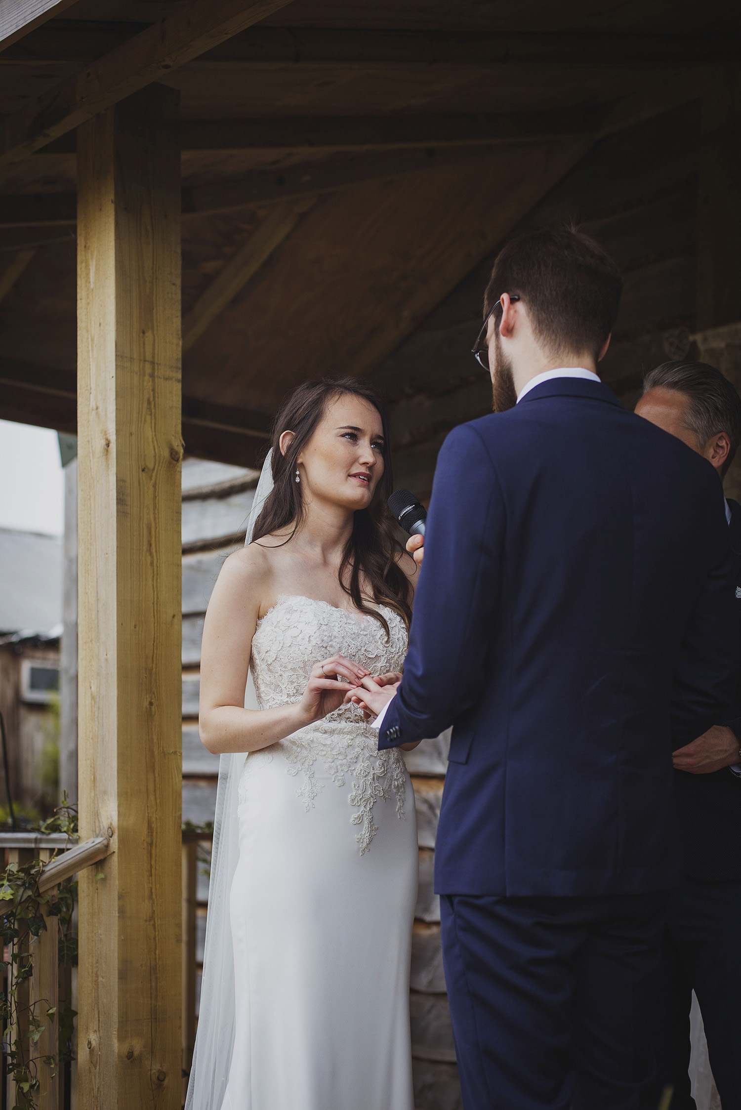 exchanging rings at wedding ceremony at cott farm barn wedding venue somerset