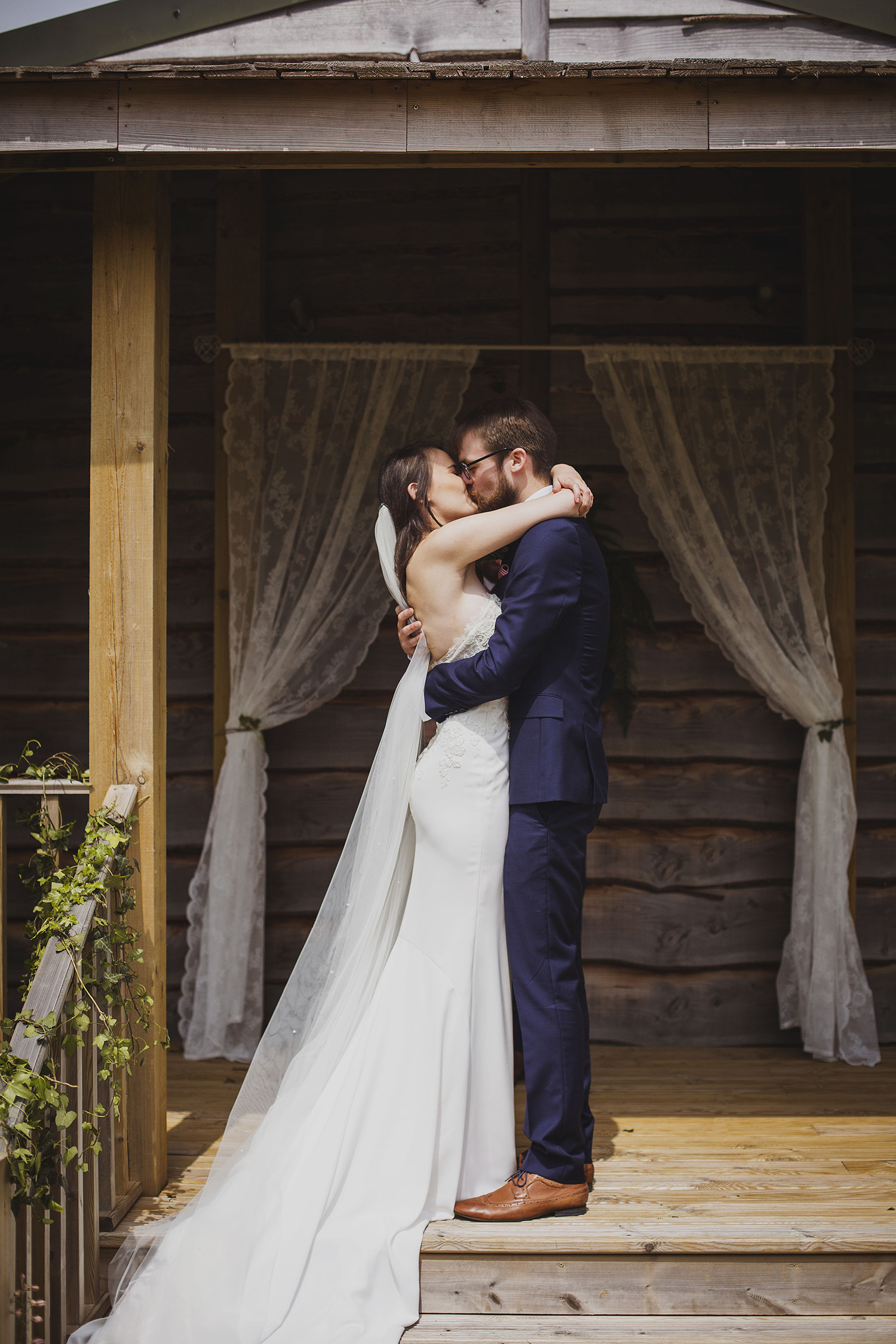 first kiss just married at cott farm barn wedding venue somerset