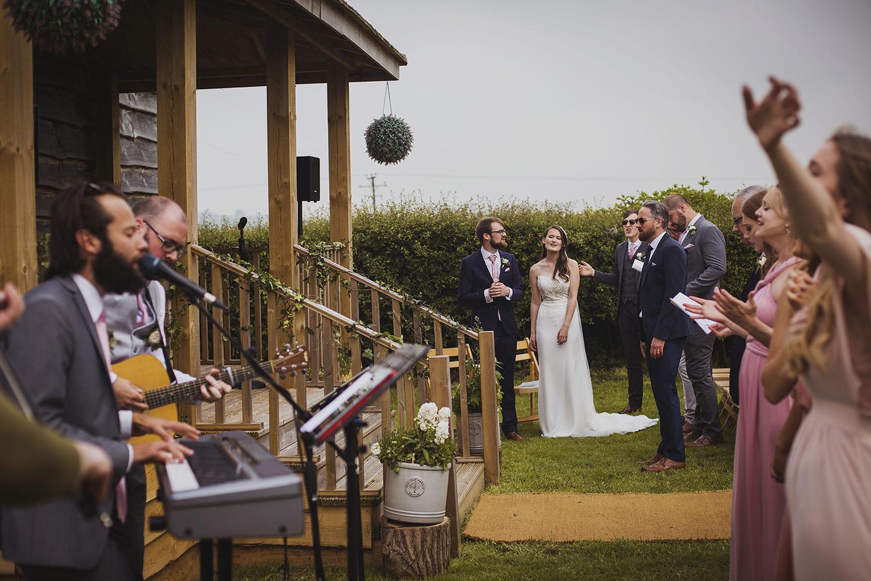 worship at wedding ceremony at cott farm barn wedding venue somerset