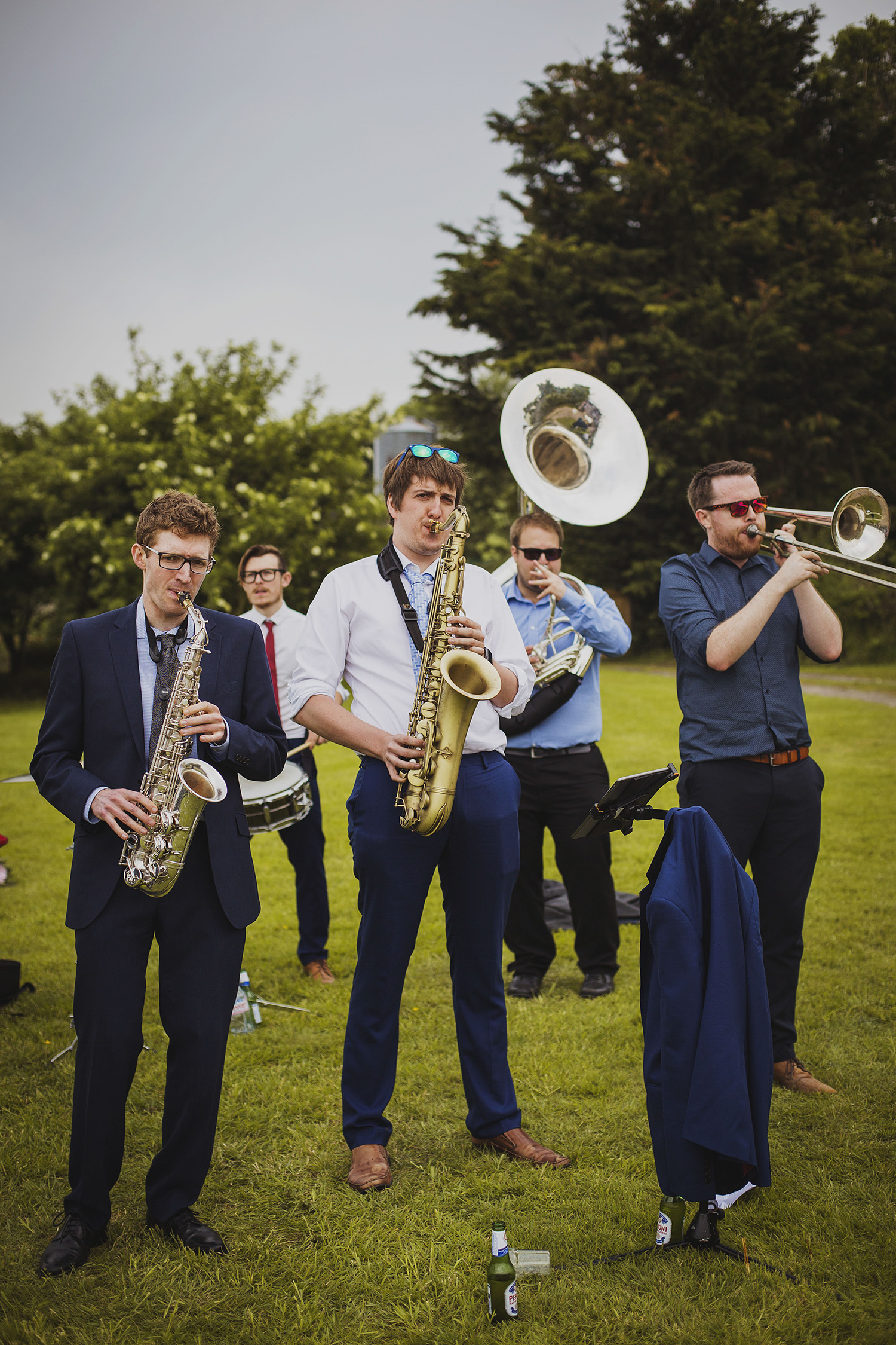 tuba libres playing after bride and groom walking down the isle at wedding ceremony at cott farm barn wedding venue somerset