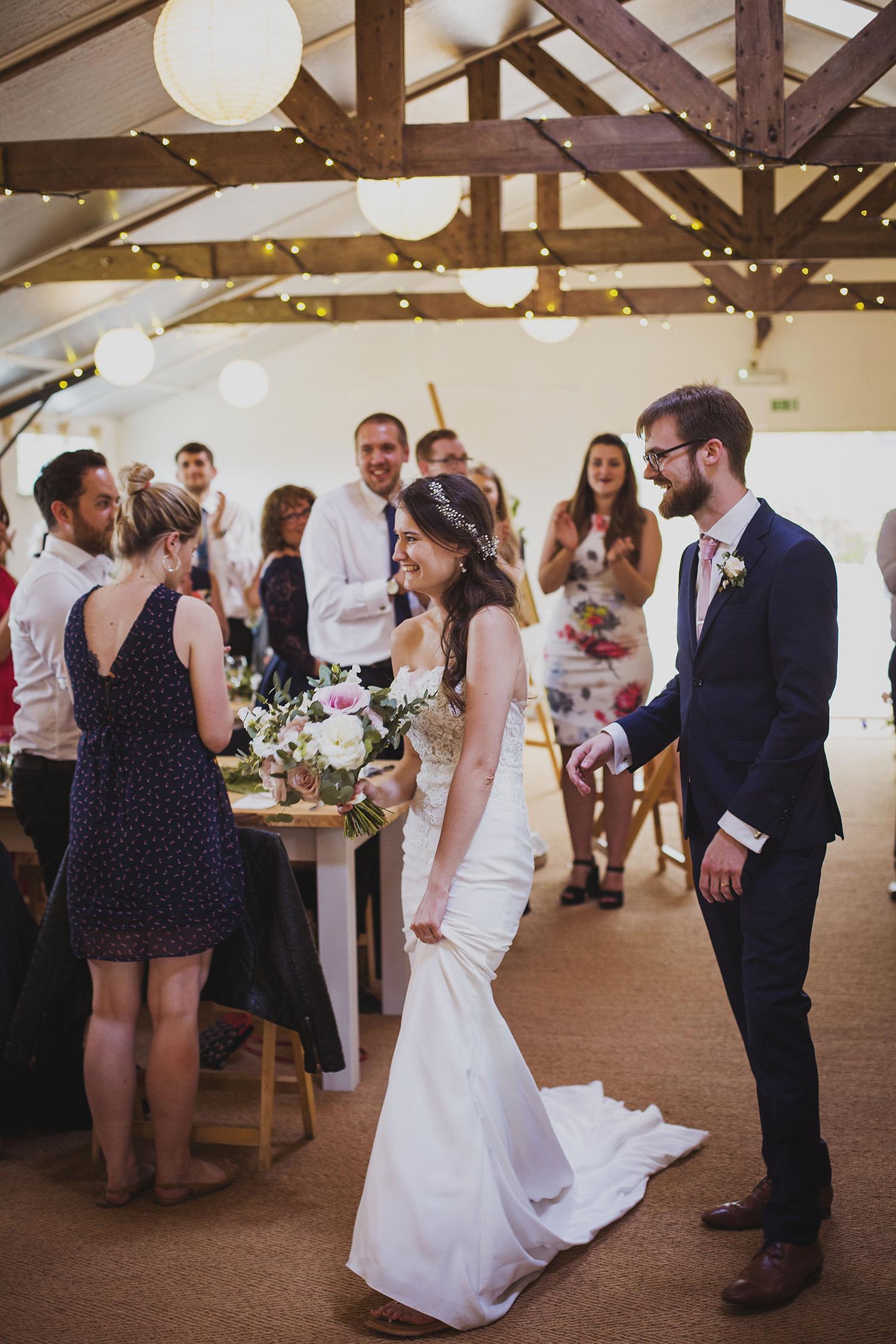 bride and groom entrance at cott farm barn wedding venue somerset