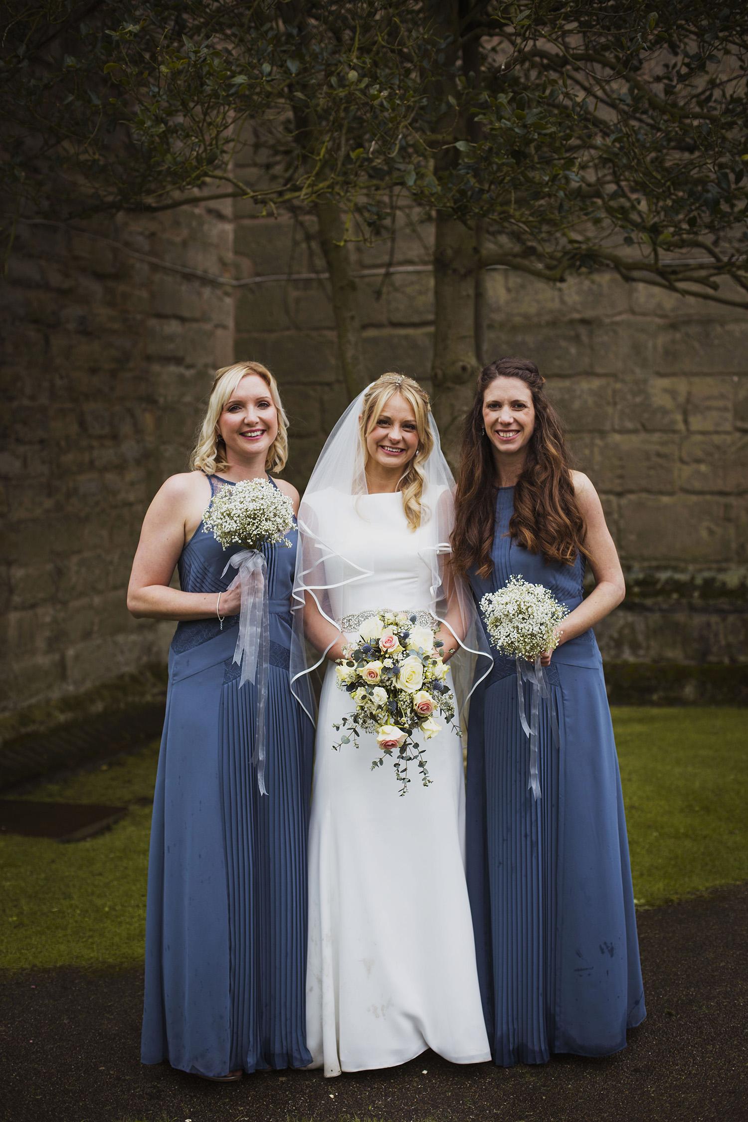 bride with bridesmaids at knowle parish church wedding