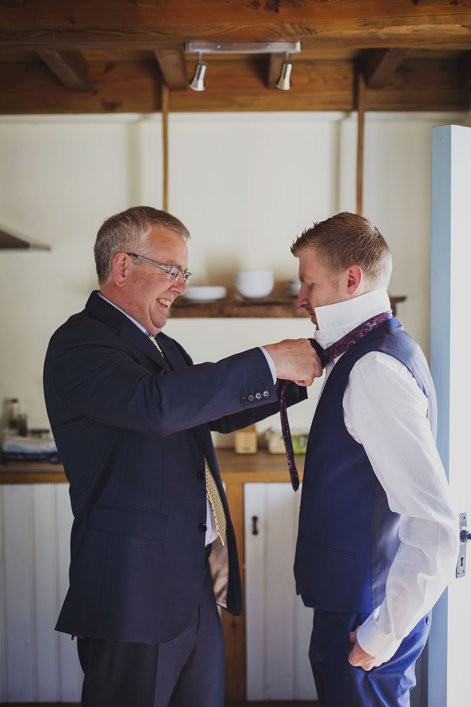 groom with father at nantwen wedding venue pembrokeshire