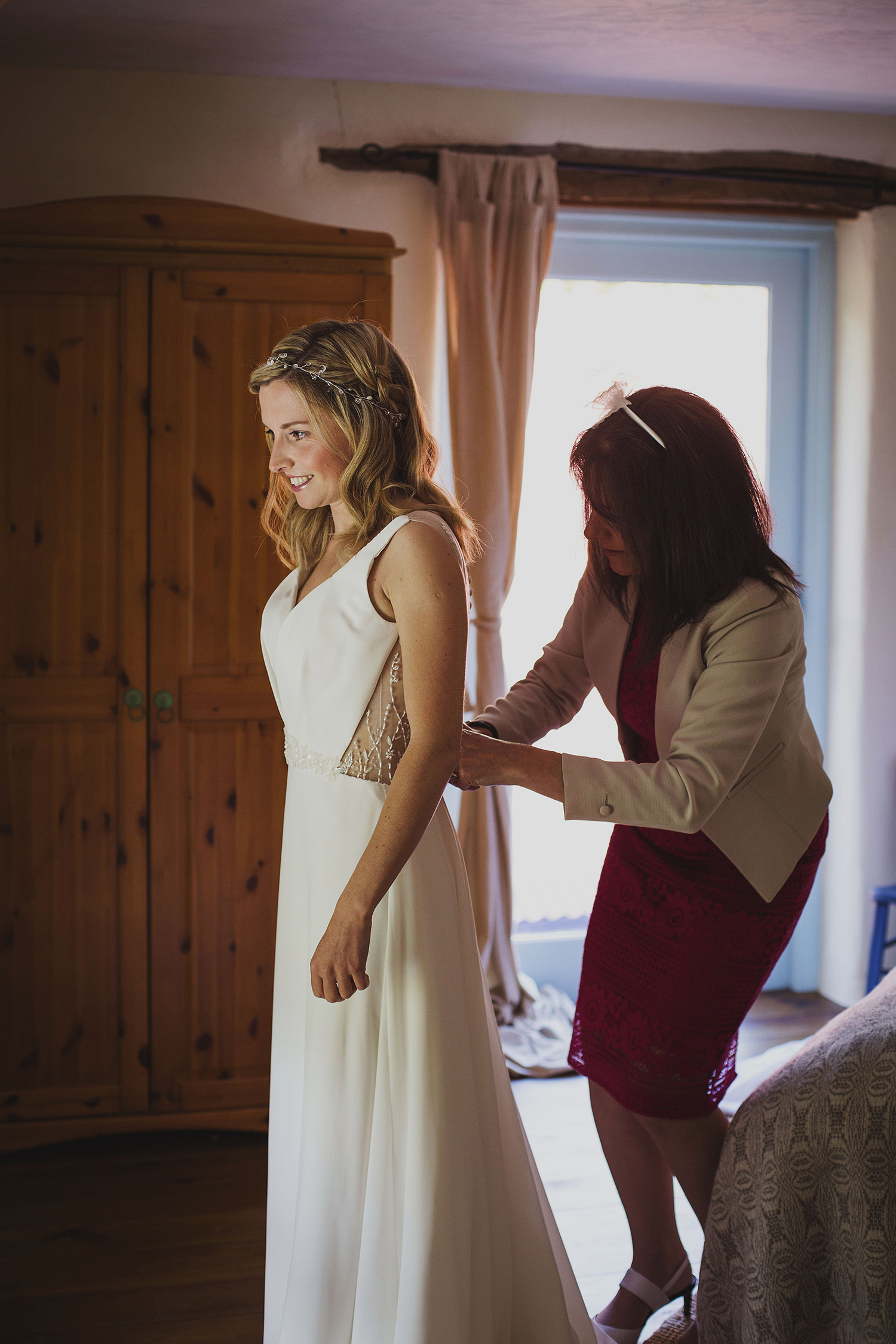 bride getting into dress at nantwen wedding