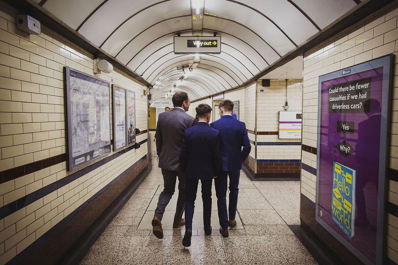 groom embankment underground tube corinthia hotel london wedding photographer
