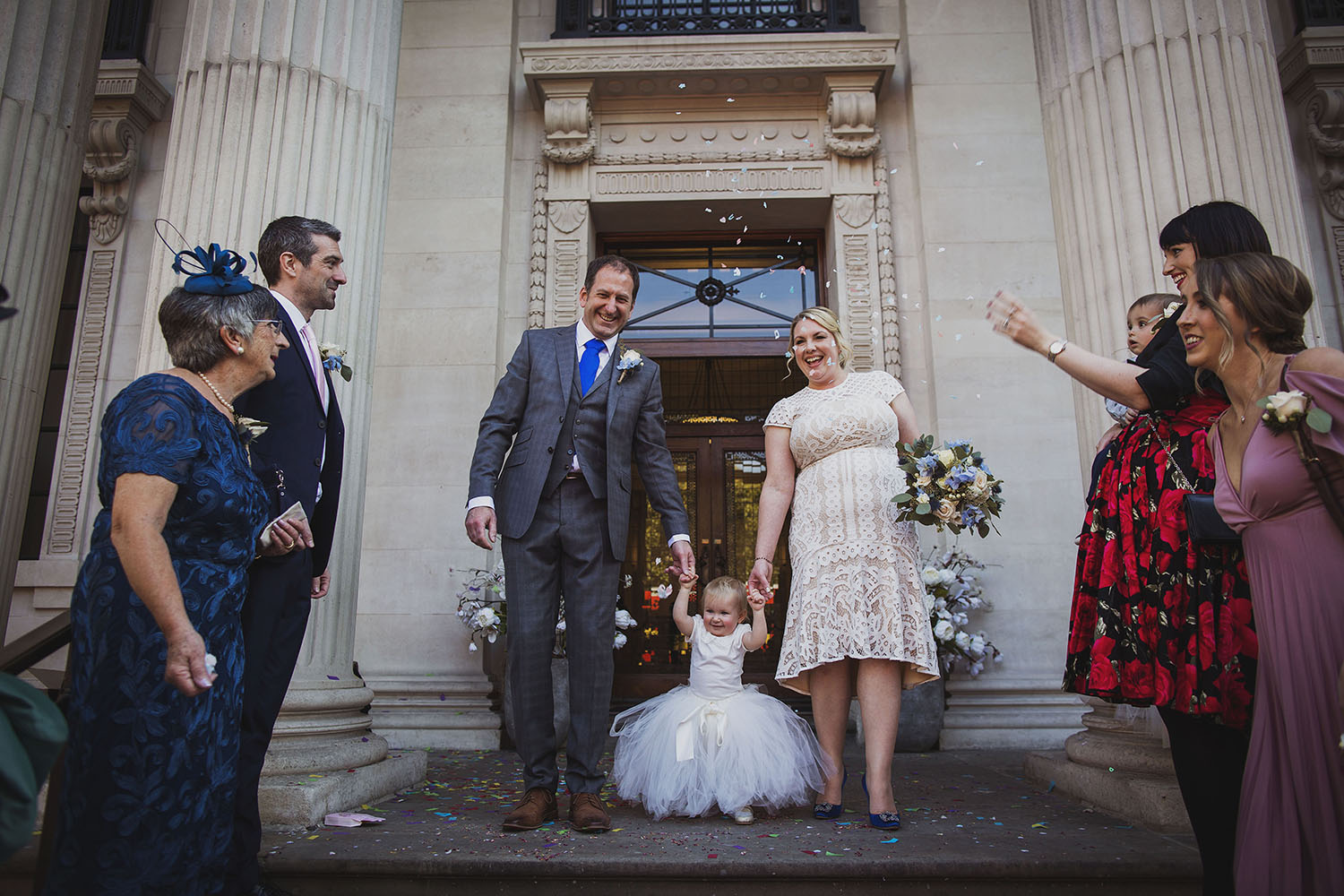 confetti on steps of the old marylebone town hall wedding photographer