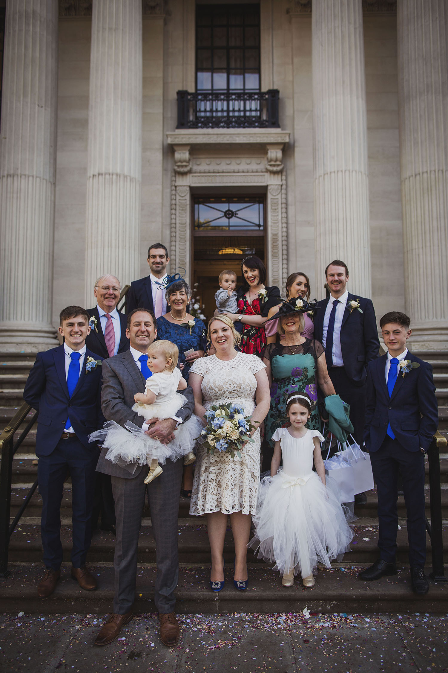 group wedding family photo on steps of the old marylebone town hall wedding photographer