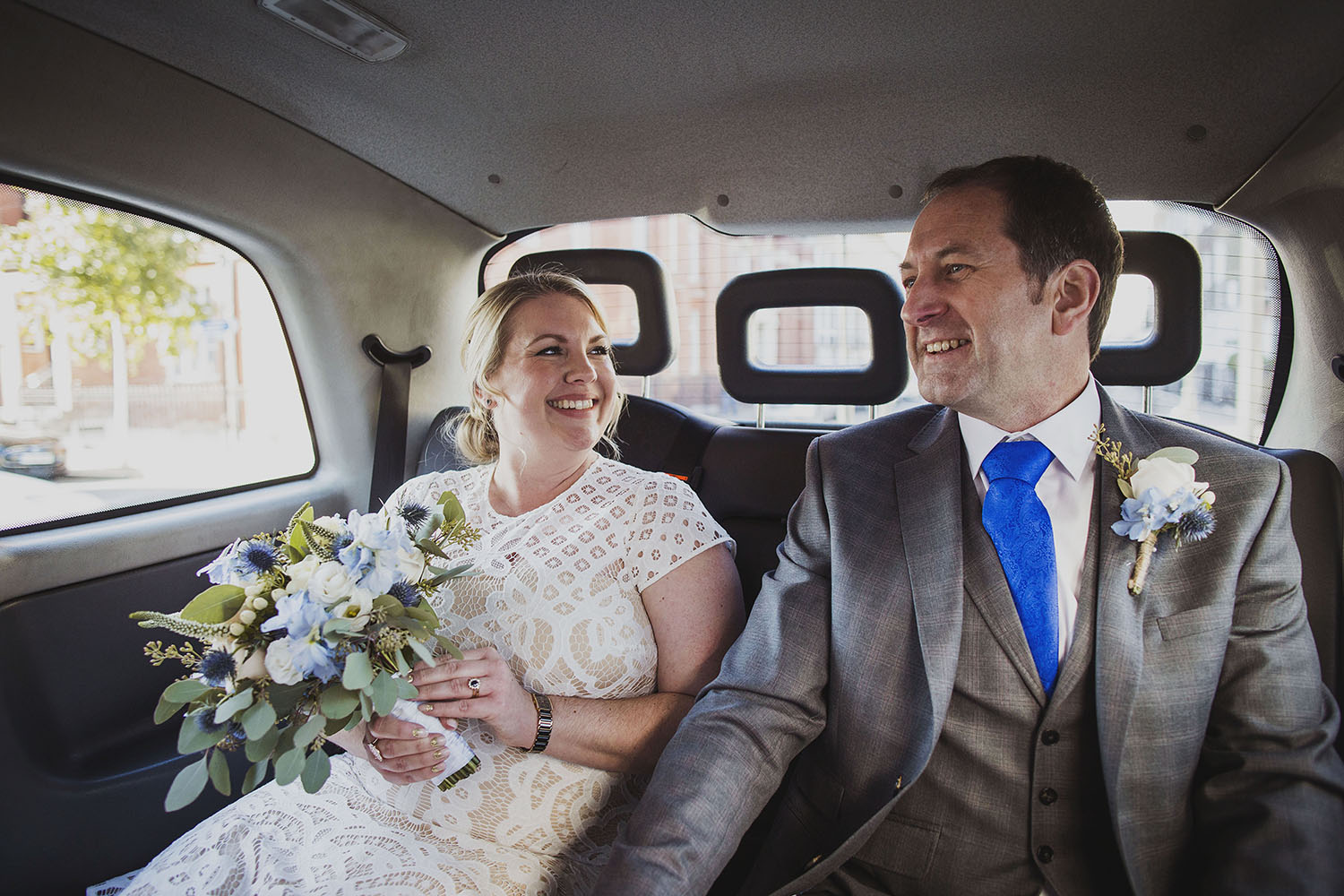 bride and groom in taxi corinthia hotel london wedding photographer