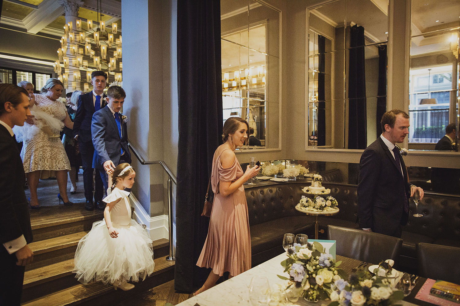 wedding guests arrive wedding breakfast in northall rooms corinthia hotel london wedding photographer