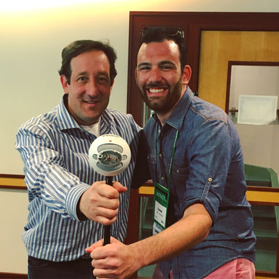 Two Skidmore alumni, David Miner '91 and Jared Greenbaum '12, meet during the recording of one episode of This is Skidmore. The aforementioned Snowball Mic is featured prominently.