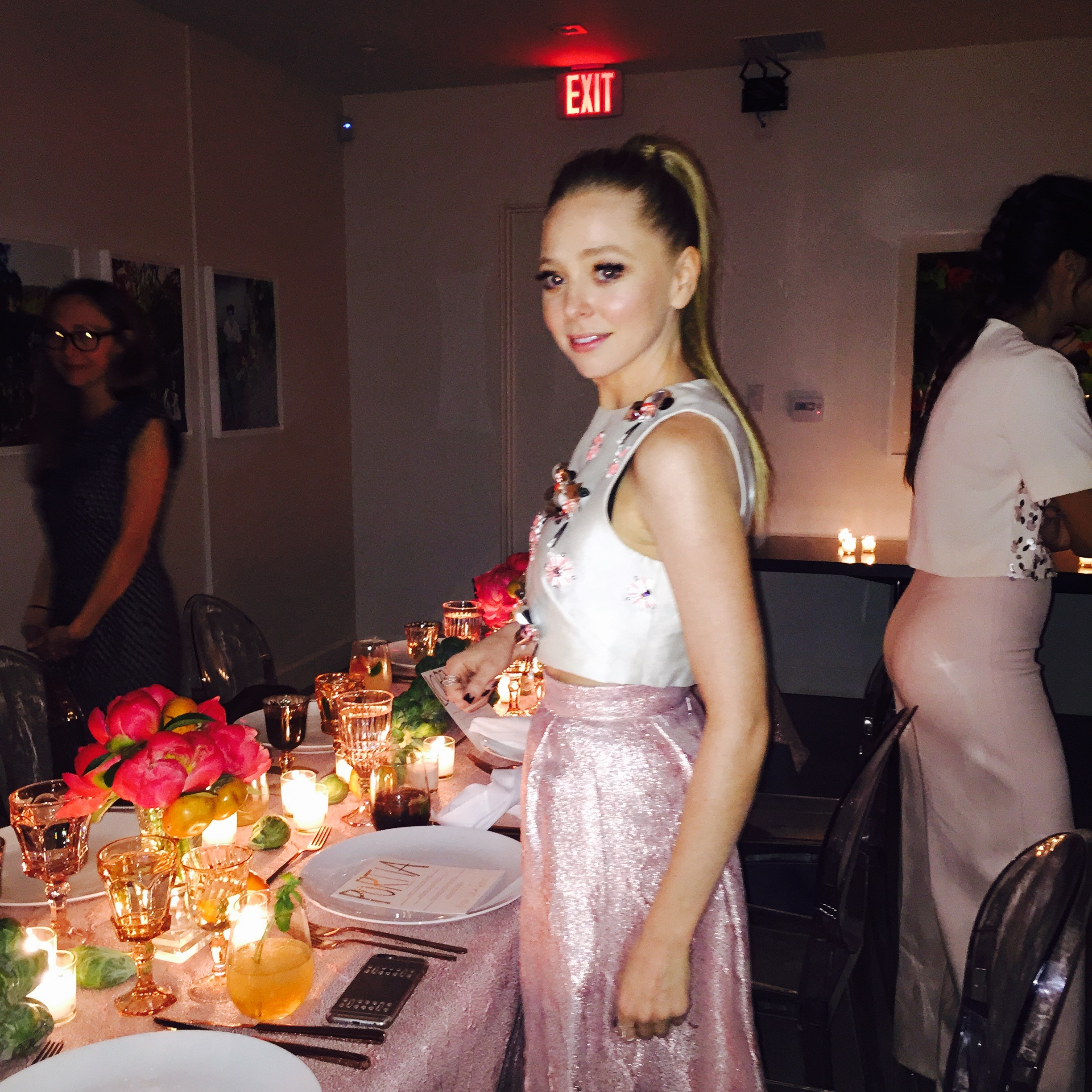 Actress  Portia Doubleday  enjoying Lela Rose's party. Don't you just love how beautifully Portia's skirt compliments Lela's tablecloth?