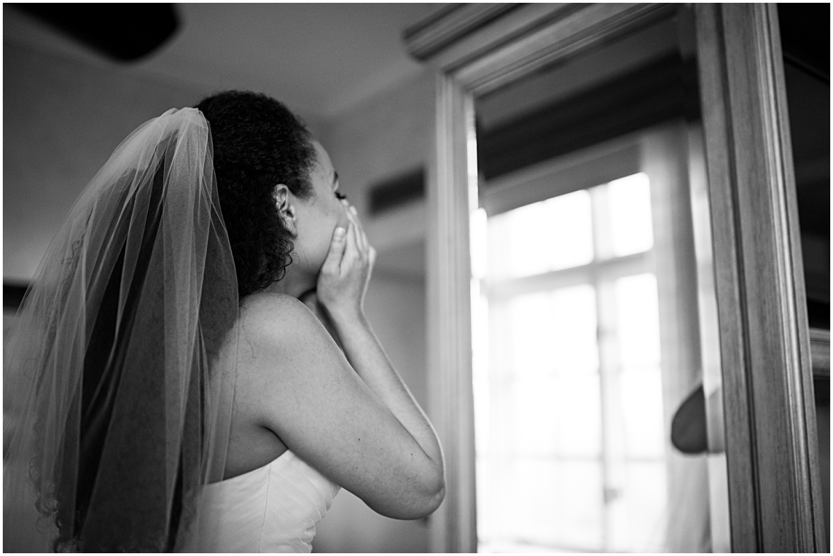 bride crying in the mirror