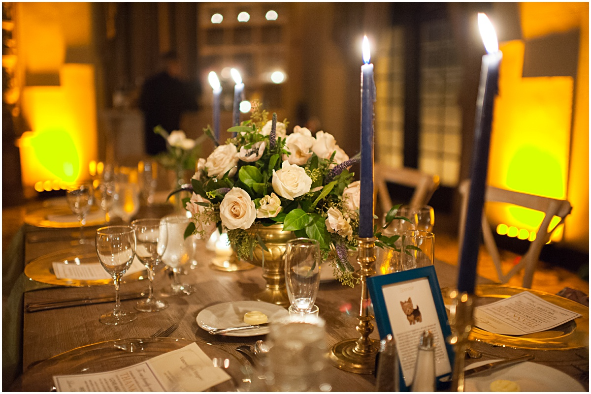 blue candles on a white wash farm table
