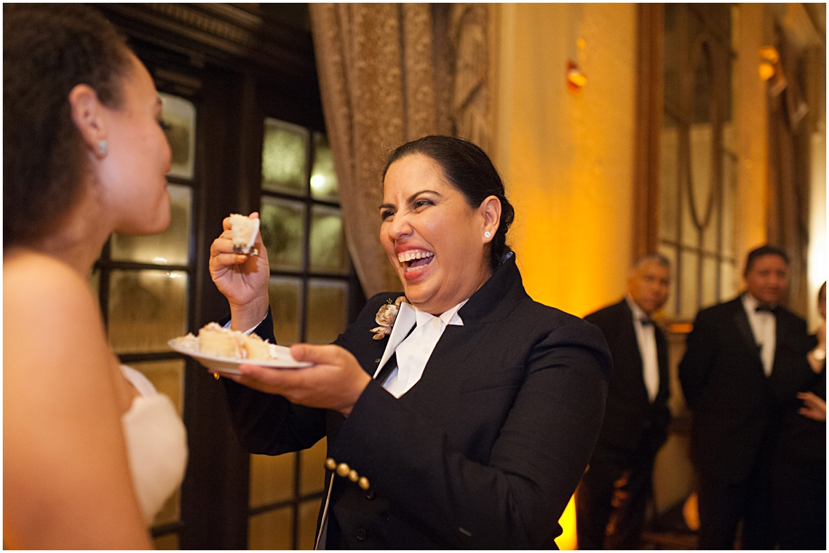 same sex couple cutting the cake at the biltmore hotel