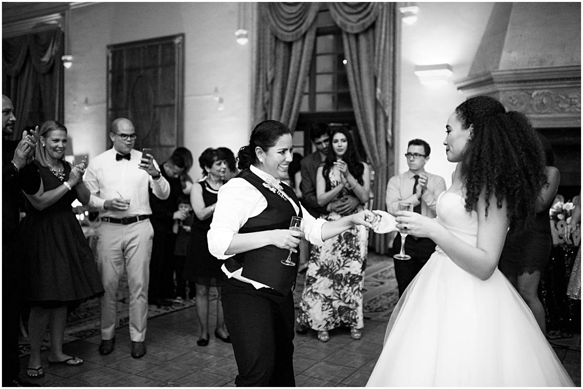 black and white reception photo of newlyweds